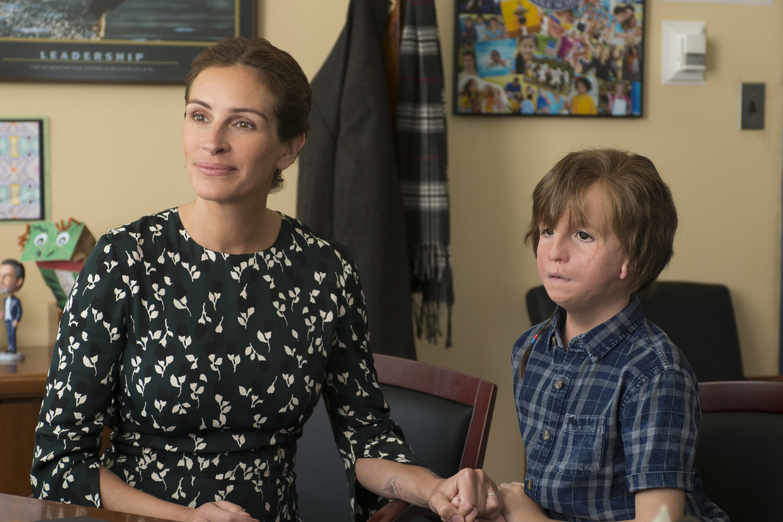 """This image released by Lionsgate shows Jacob Tremblay, right, and Julia Roberts in a scene from """"Wonder."""" (Dale Robinette/Lionsgate via AP)"""