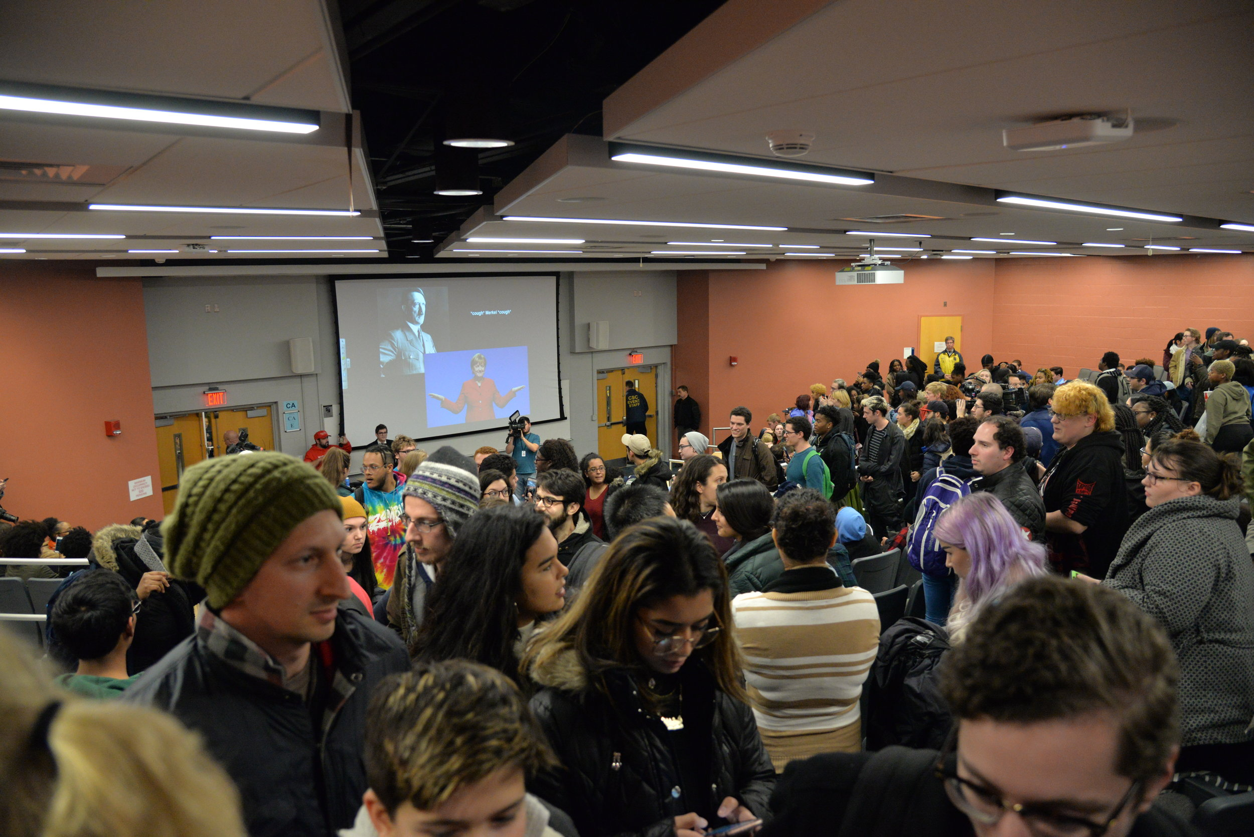 Protestors began to get up and walk out during the middle of the lecture. (Amar Batra/The Daily Campus)