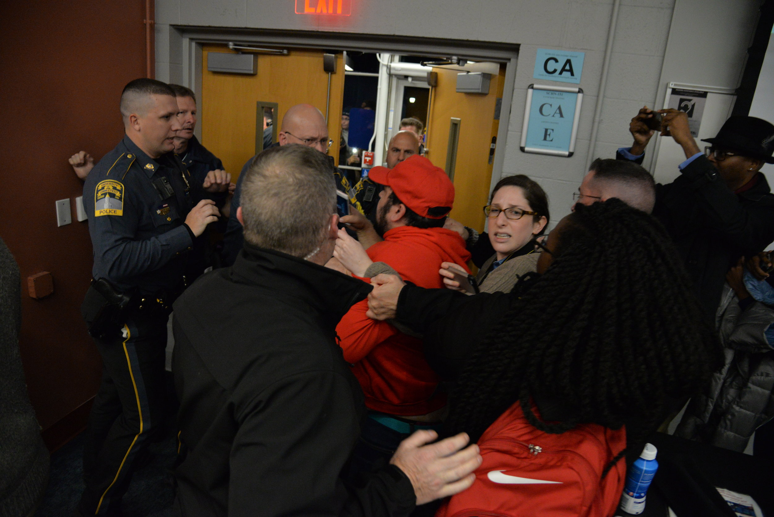 UCPD officers quickly escorted Wintrich through a scrum of people and out of the lecture hall. (Amar Batra/The Daily Campus)