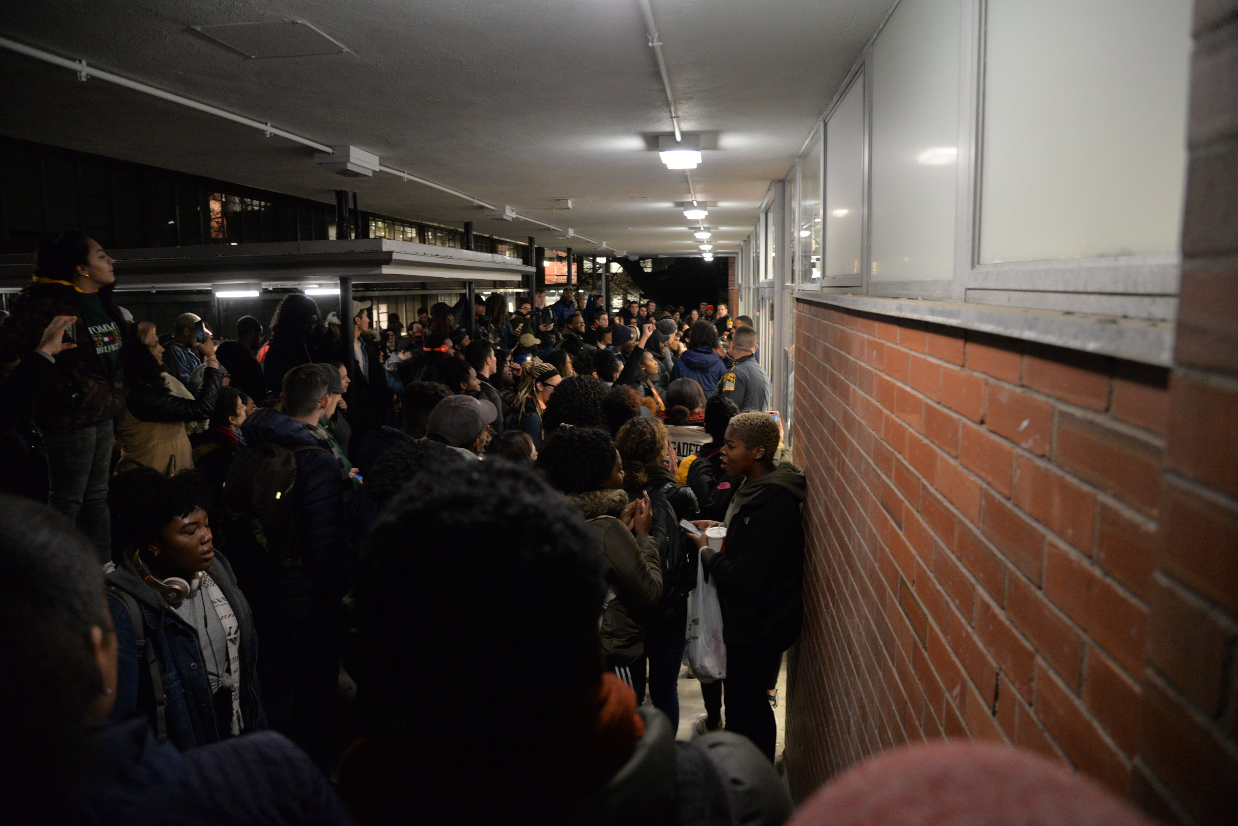 The event was officially canceled once the altercation took place, but that didn't stop the masses of people from gathering outside Schenker Hall. There were also reports of a smoke bomb going off inside the building. (Amar Batra/The Daily Campus)
