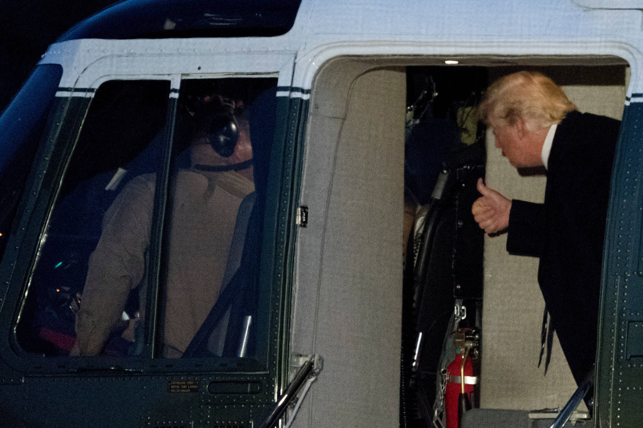 President Donald Trump gives a thumbs up to the crew of Marine One as he arrives on the South Lawn of the White House in Washington, Saturday, Dec. 2, 2017, after Trump traveled to New York for a fundraising event. (AP Photo/Andrew Harnik)