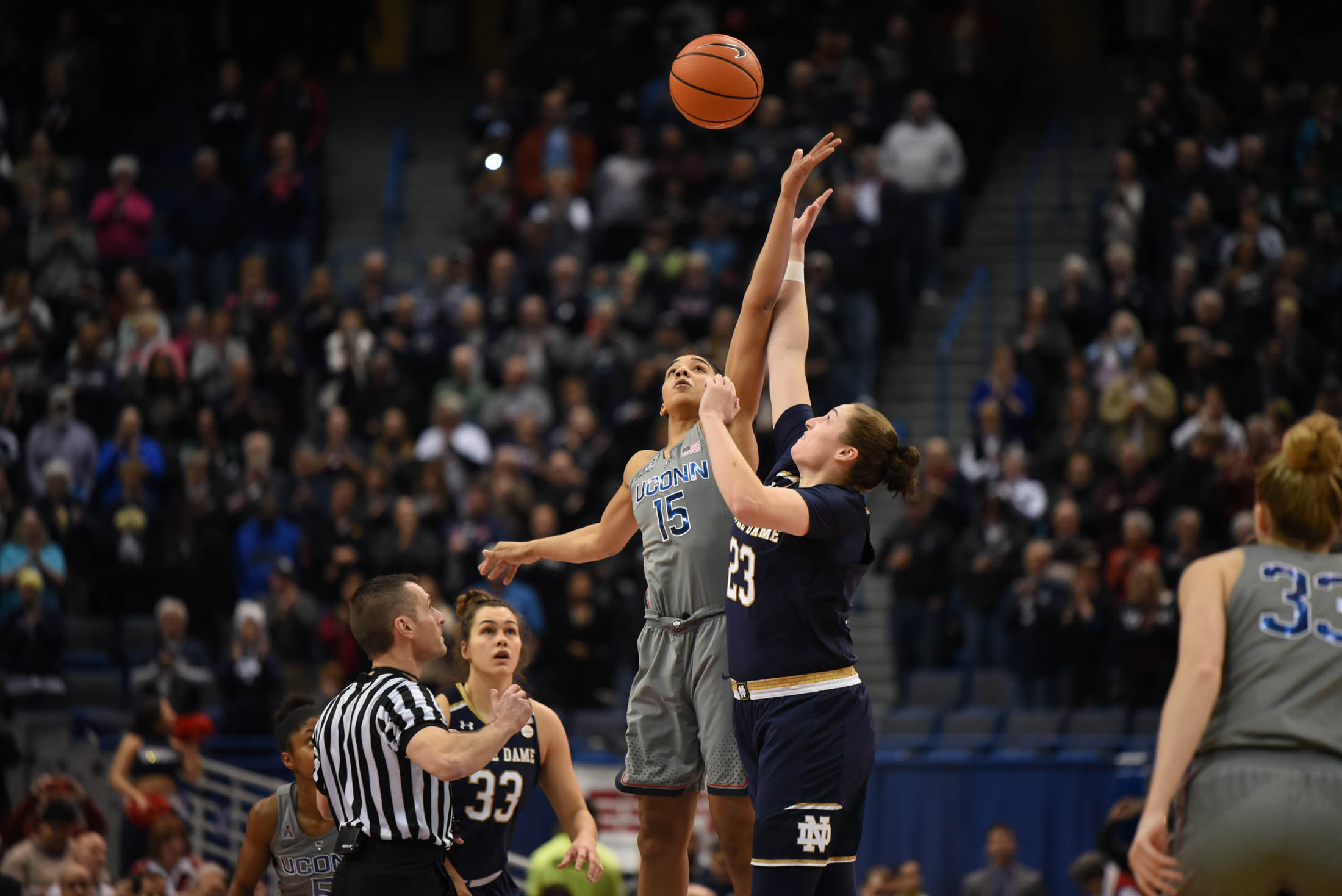 Gabby Williams jumps to win the tip off to start the game against Notre Dame. (Charlotte Lao/The Daily Campus)