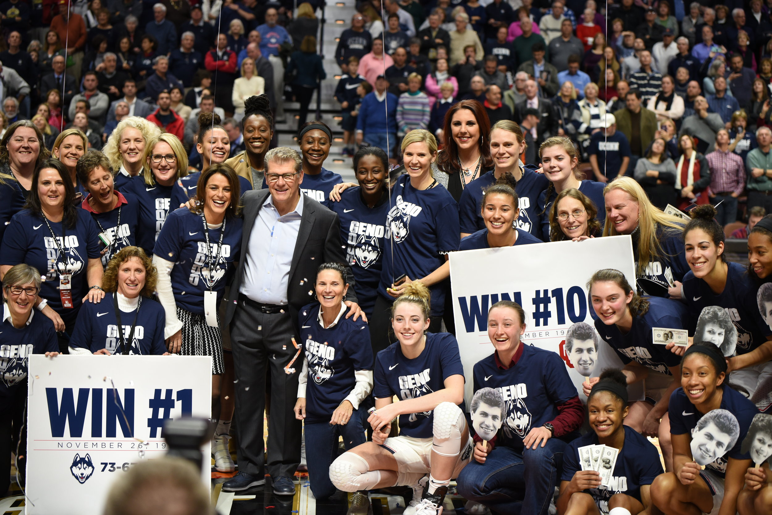 UConn head coach Geno Auriemma celebrates his 1000th career win with several of his former players, along with his current team. The Huskies' defeated the Oklahoma Sooners 88-64 Tuesday night at Mohegan Sun Arena in Uncasville, Connecticut. (Charlotte Lao, Associate Photo Editor/The Daily Campus)