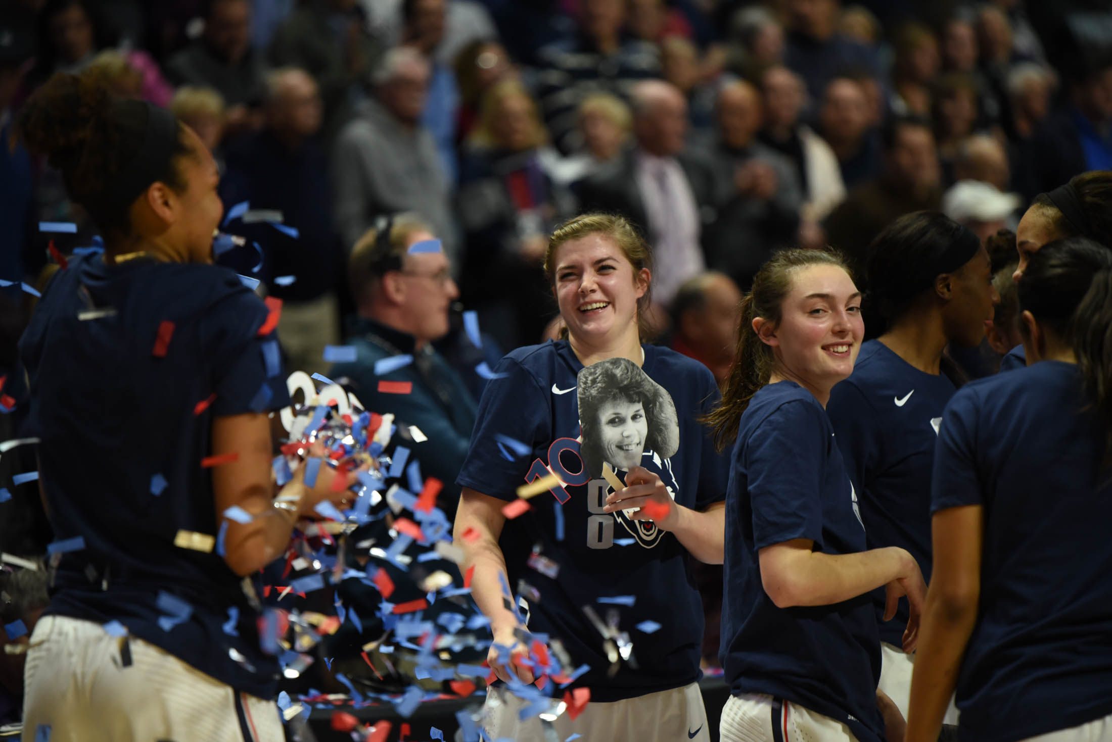 Kyla Irwin and Azurá Stevens celebrate the win with confetti. (Charlotte Lao/The Daily Campus)