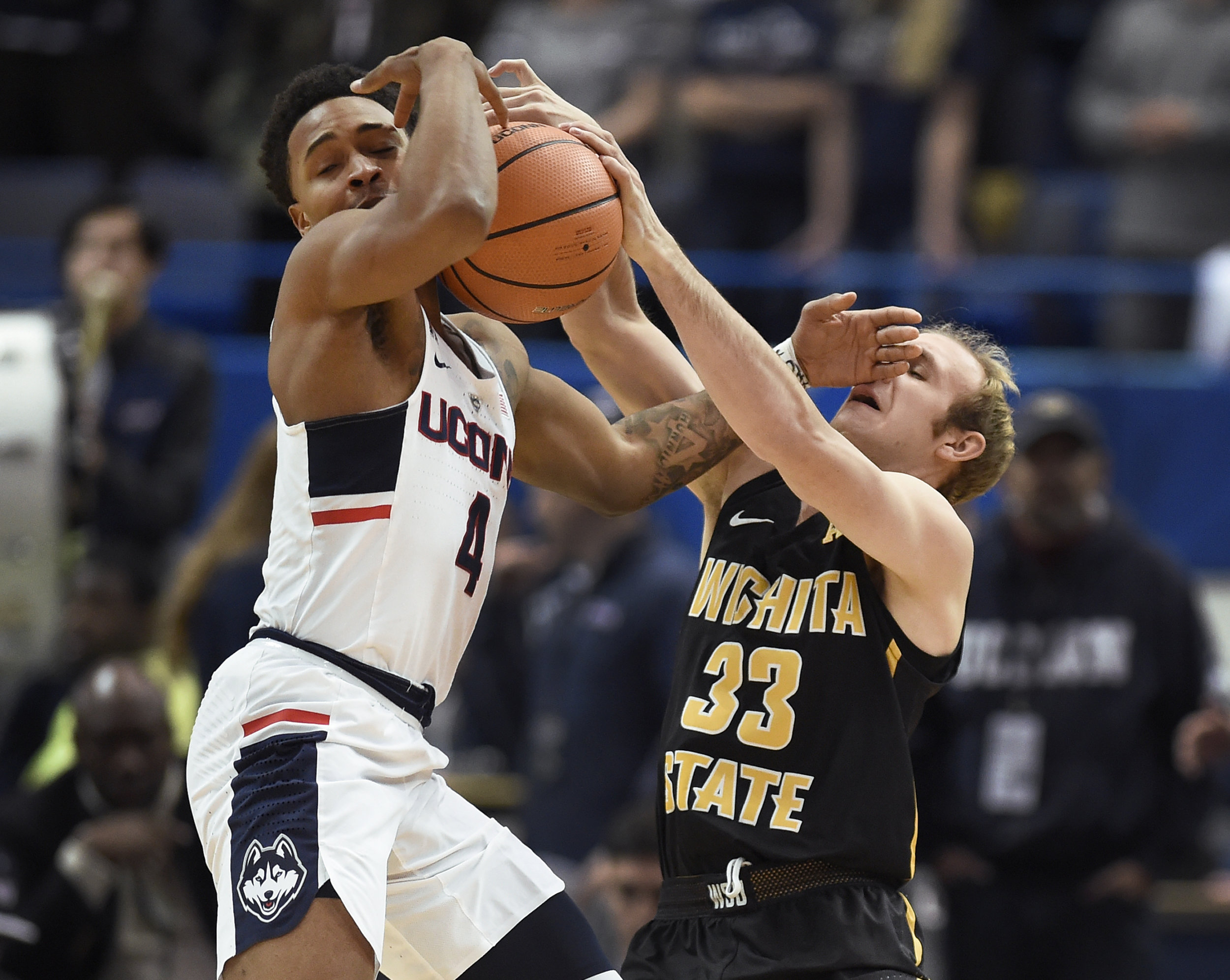 Wichita State's Conner Frankamp, right, pressures Connecticut's Jalen Adams during the first half of an NCAA college basketball game, Saturday, Dec. 30, 2017, in Hartford, Conn. (AP Photo/Jessica Hill)