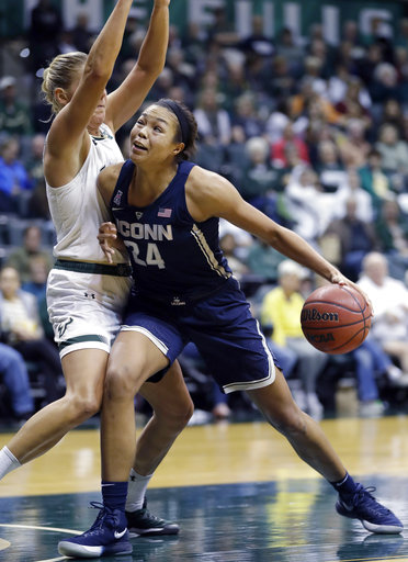 South Florida forward Maria Jespersen blocks the lane as Connecticut forward Napheesa Collier (24) tries to go to the basket during the third quarter of an NCAA college basketball game Saturday, Jan. 6, 2018, in Tampa, Fla. UConn won 100-49. (AP Photo/Chris O'Meara)