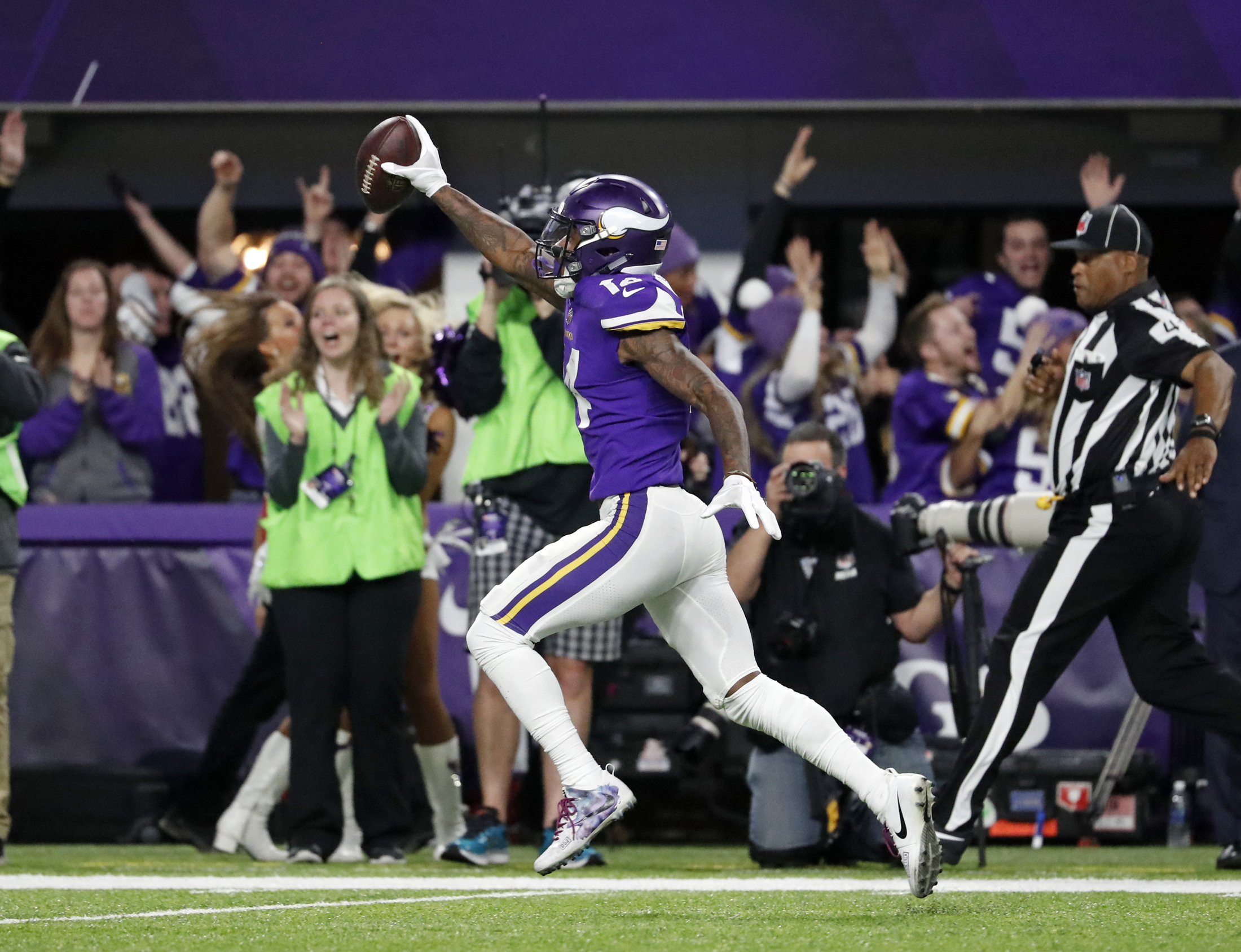 FILE - In this Sunday, Jan. 14, 2018, file photo, Minnesota Vikings wide receiver Stefon Diggs (14) runs in for a game winning touchdown against the New Orleans Saints during the second half of an NFL divisional football playoff game in Minneapolis. (Jeff Roberson, File/AP)