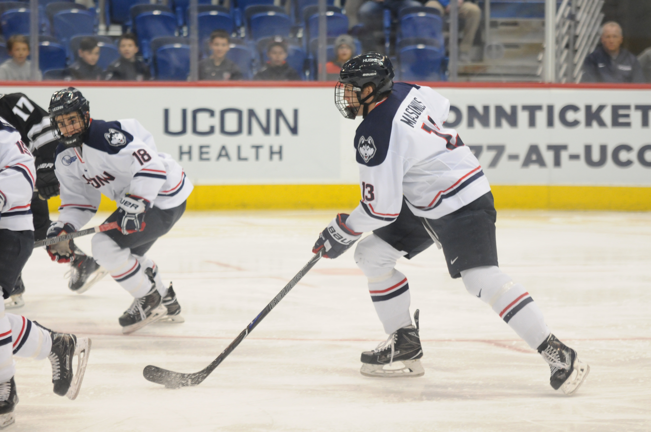 Joseph Masonius (13) glides across the ice during the Huskies 3-1 loss to the Providence Friars on Thursday evening. (Eric Wang/The Daily Campus)