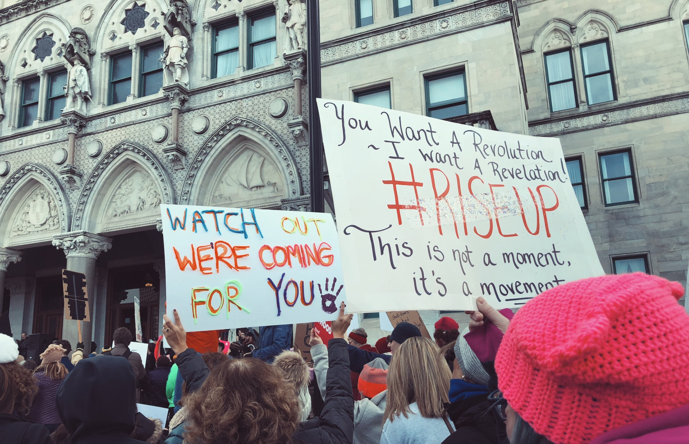"""Thousands of people wearing """"pussy hats,"""" shouting chants and carrying witty posters stretched as far as the eye could see, filling what felt like every block in New York City for the annual Women's March. (Armana Islam/The Daily Campus)"""