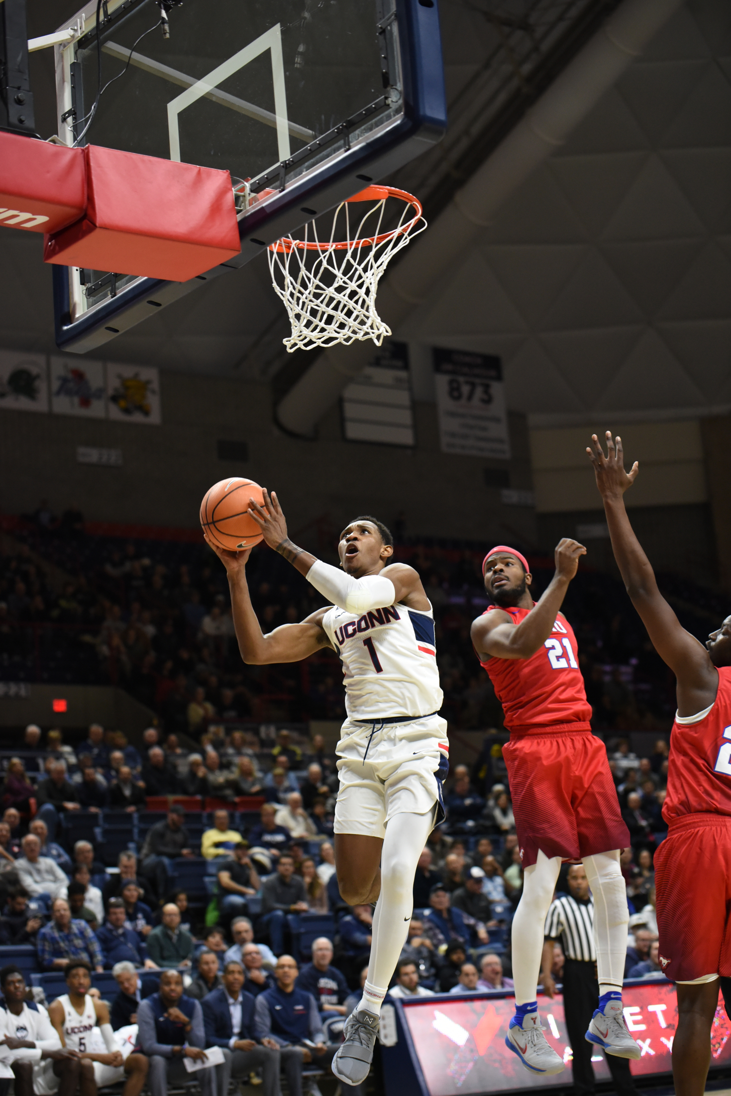 Sophomore guard Christian Vital (1) completes layup during the Huskies 63-52 victory over the SMU Mustangs on Thursday, Jan. 26, 2017 at Gampel Pavilion. (Charlotte Lao/The Daily Campus)