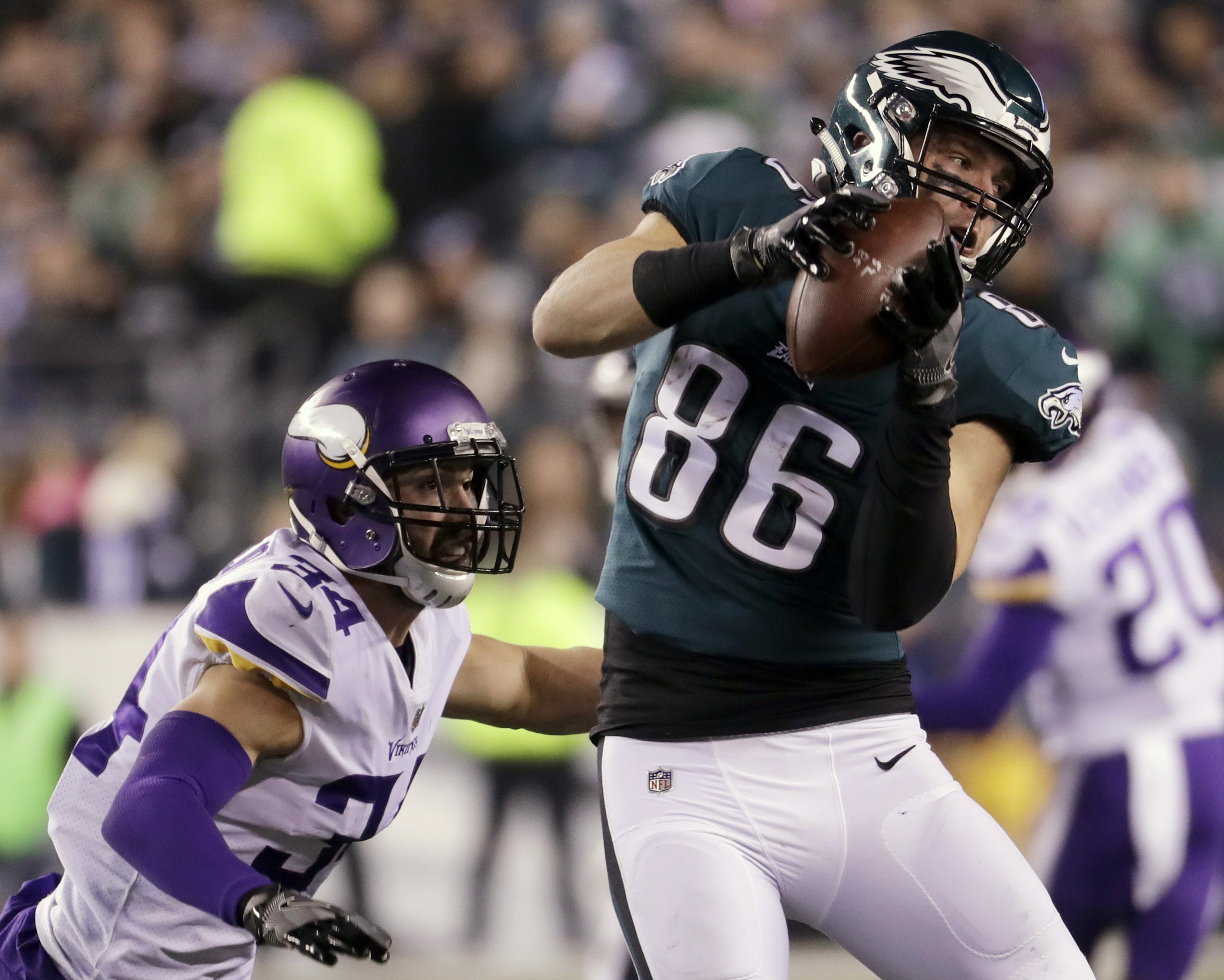FILE - In this Sunday, Jan. 21, 2018, file photo Philadelphia Eagles' Zach Ertz catches a pass in front of Minnesota Vikings' Andrew Sendejo during the first half of the NFL football NFC championship game in Philadelphia. The Eagles and the New England Patriots are set to meet in Super Bowl 52 on Sunday, Feb. 4, 2018, in Minneapolis. (AP Photo/Michael Perez, File)