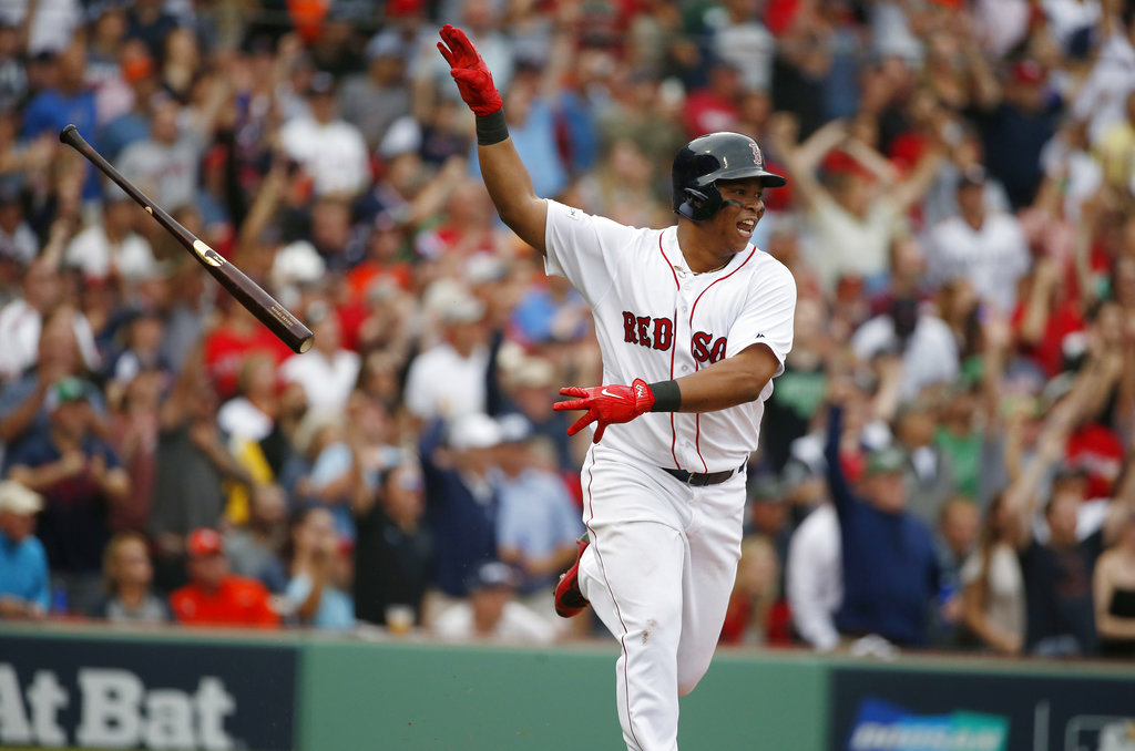 In this Oct. 8, 2017, file photo, Boston Red Sox's Rafael Devers tosses his bat after hitting a two-run home run against the Houston Astros during the third inning in Game 3 of baseball's American League Division Series, in Boston. (AP Photo/Michael Dwyer, File)