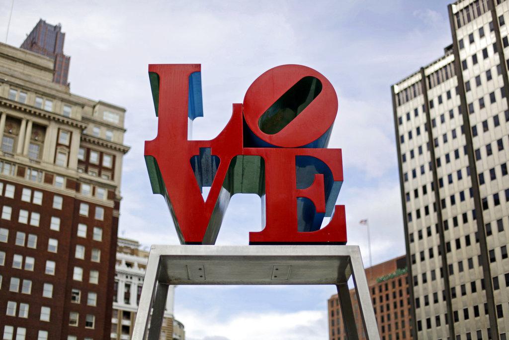 FILE - This Nov. 10, 2010, file photo, shows artist Robert Indiana's LOVE sculpture in John F. Kennedy Plaza, also known as Love Park, in Philadelphia. (AP Photo/Matt Rourke, File)