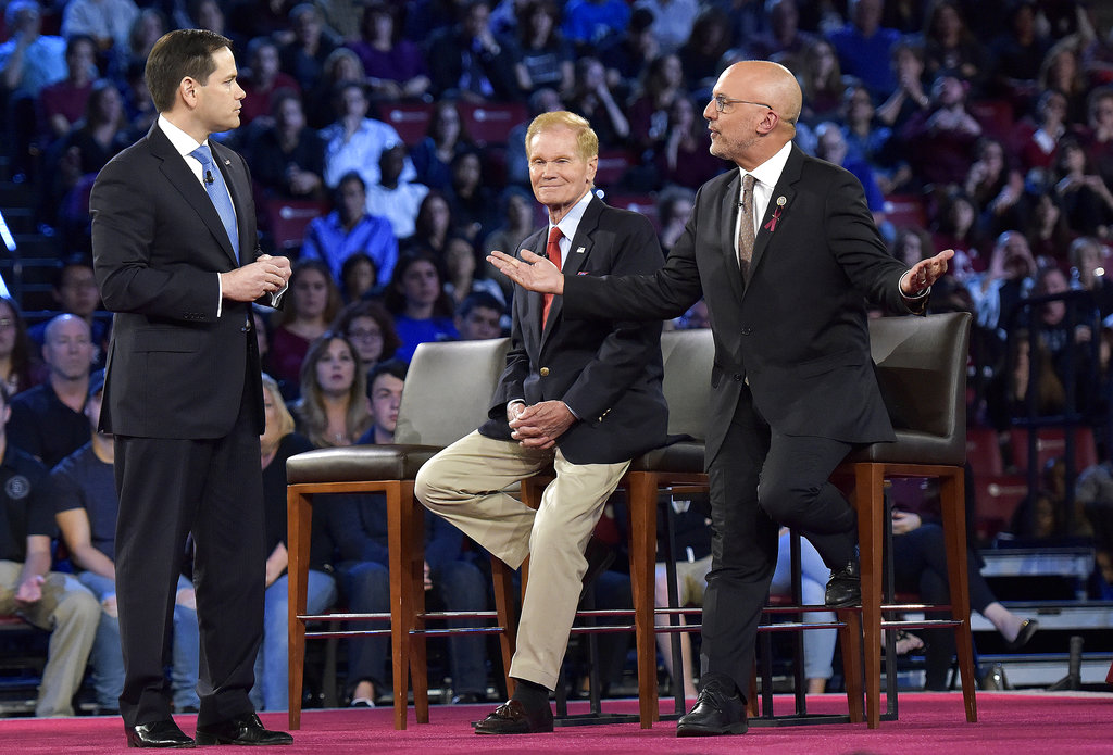 Democratic Rep. Ted Deutch of Florida, right, disagrees with Sen. Marco Rubio during a CNN town hall meeting, Wednesday, Feb. 21, 2018, at the BB&T Center, in Sunrise, Fla. (Michael Laughlin/South Florida Sun-Sentinel via AP)