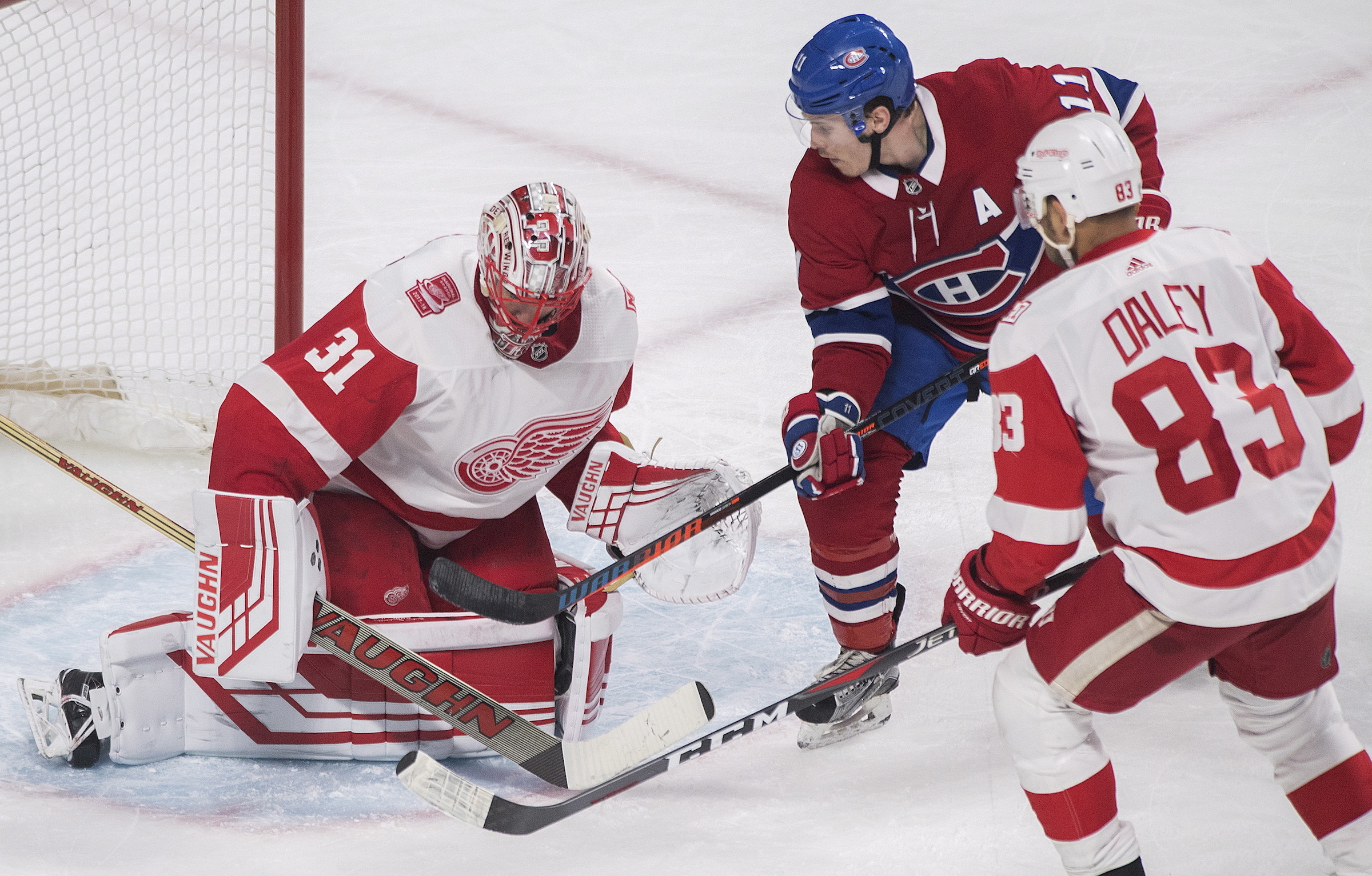 Montreal Canadiens right wing Brendan Gallagher (11) moves in against Detroit Red Wings goaltender Jared Coreau (31) as defenseman Trevor Daley (83) defends during third-period NHL hockey game action in Montreal, Monday, March 26, 2018. (Graham Hughes/The Canadian Press via AP)