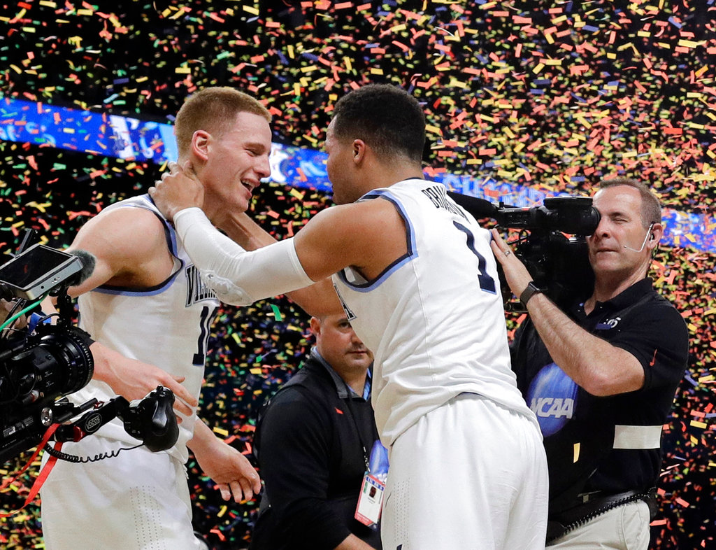 Villanova's Donte DiVincenzo, left, and Jalen Brunson celebrate after the championship game of the Final Four NCAA college basketball tournament against Michigan, Monday, April 2, 2018, in San Antonio. Villanova won 79-62. (AP Photo/David J. Phillip)