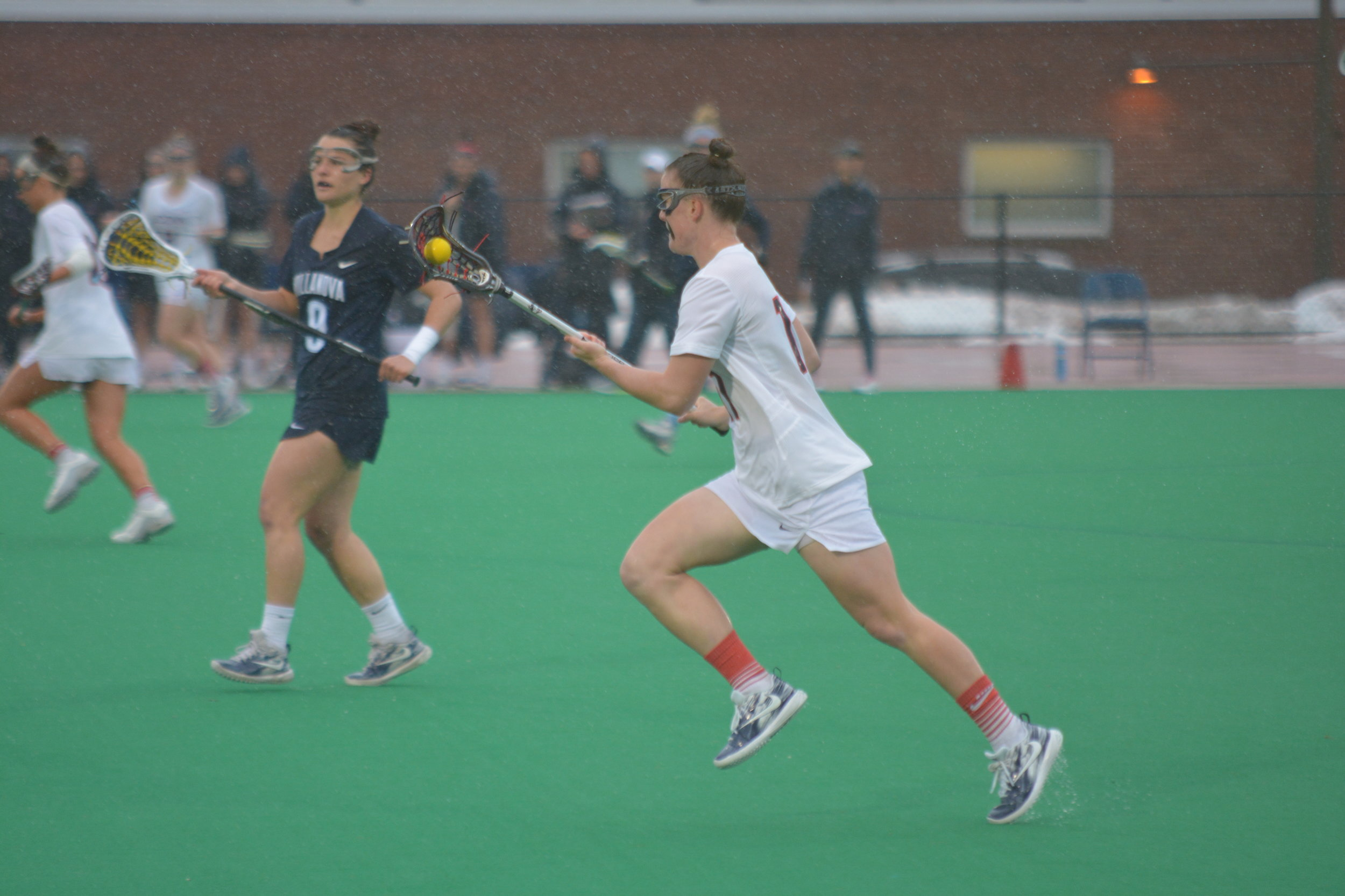 UConn Women's Lacrosse plays a tough game against Villanova in the rain Wednesday afternoon. (Nick Hampton/The Daily Campus)