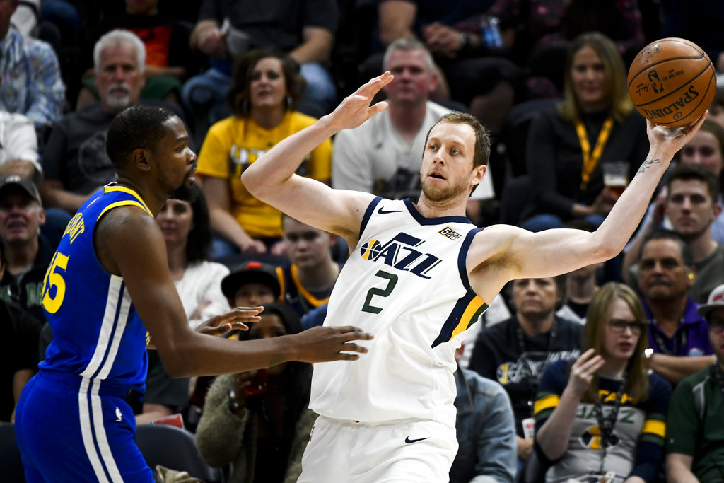Utah Jazz forward Joe Ingles (2) attempts to pass around Golden State Warriors forward Kevin Durant (35) in the first half of an NBA basketball game Tuesday, April 10, 2018, in Salt Lake City. (AP Photo/Alex Goodlett)