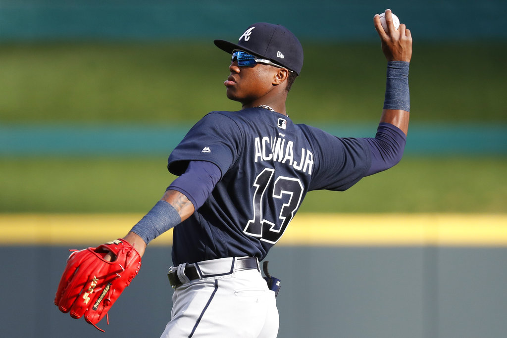 Atlanta Braves center fielder Ronald Acuna Jr. warms up for the team's baseball game against the Cincinnati Reds, Wednesday, April 25, 2018, in Cincinnati. (AP Photo/John Minchillo)