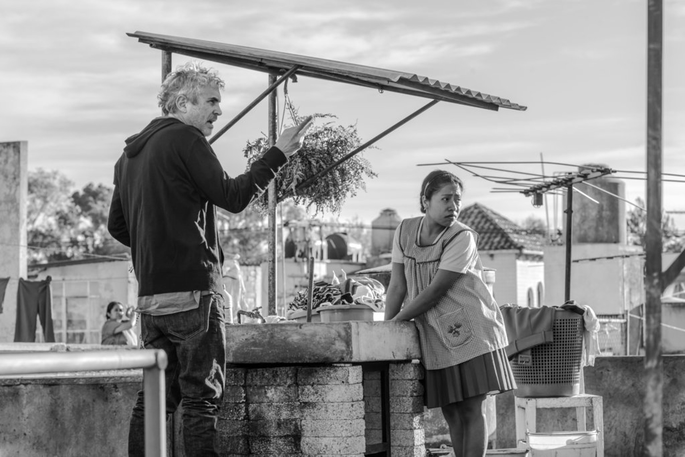 """This image released by Netflix shows filmmaker Alfonso Cuaron on the set of """"Roma,"""" premiering Oct. 5. (Carlos Somonte/Netflix via AP)"""