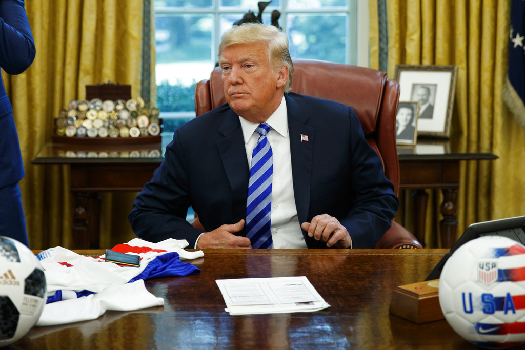 President Donald Trump listens to a question during a meeting with FIFA president Gianni Infantino and United States Soccer Federation president Carlos Cordeiro in the Oval Office of the White House, Tuesday, Aug. 28, 2018, in Washington. (AP Photo/Evan Vucci)