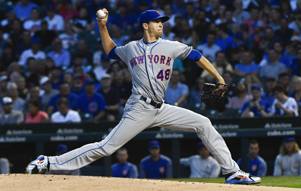 New York Mets starting pitcher Jacob deGrom (48) delivers during the first inning of a baseball game against the Chicago Cubs on Tuesday, Aug. 28, 2018, in Chicago. (AP Photo/Matt Marton)