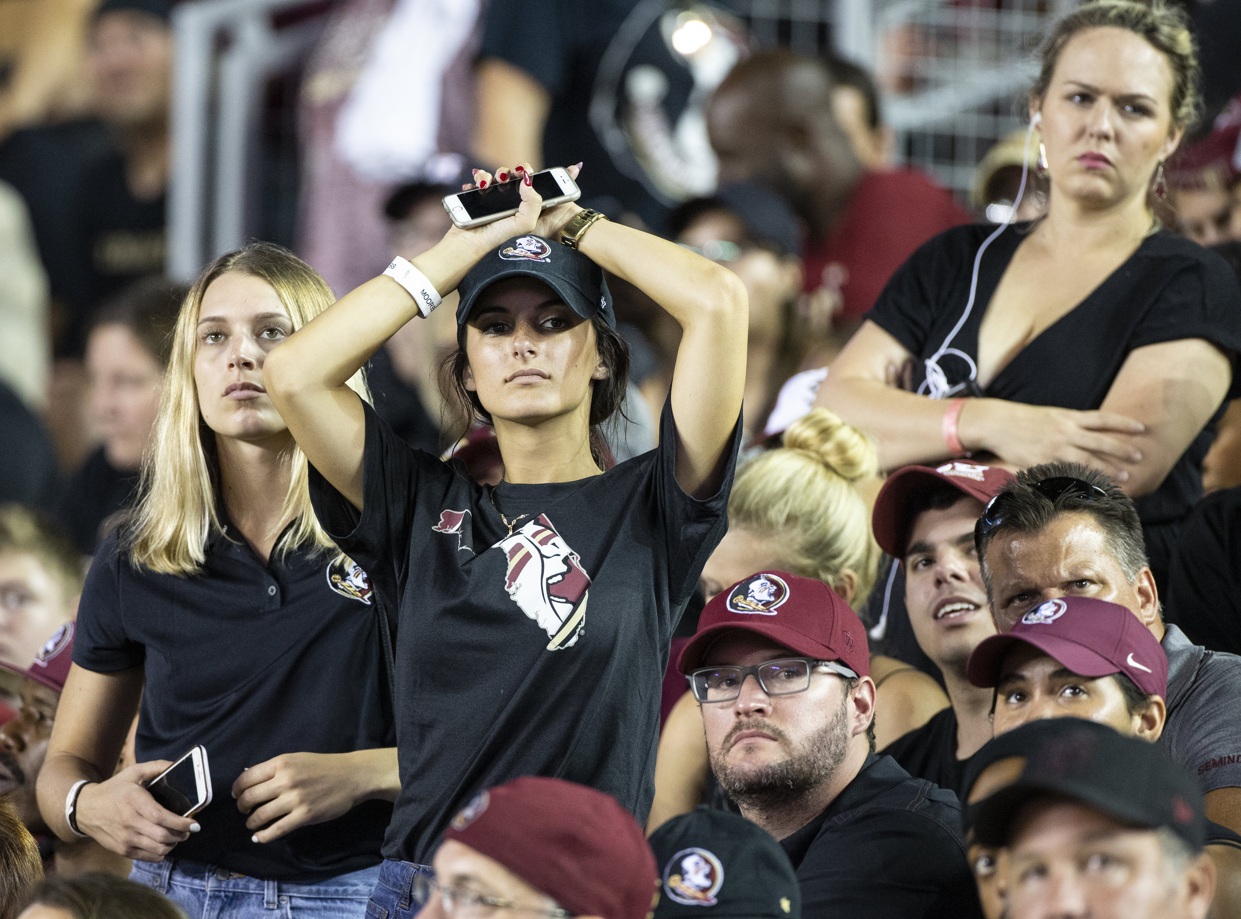 Stunned Florida State fans watch as Virginia Tech defeated them 24-3 in an NCAA college football game in Tallahassee, Fla., Monday, Sept. 3, 2018. (AP Photo/Mark Wallheiser)