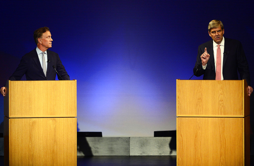 Democrat Ned Lamont, left, looks on as Republican Bob Stefanowski speaks in the first gubernatorial debate of the campaign between the two candidates the Garde Arts Center on Wednesday, Sept. 12, 2018, in New London, Conn. (Sarah Gordon/The Day via AP)