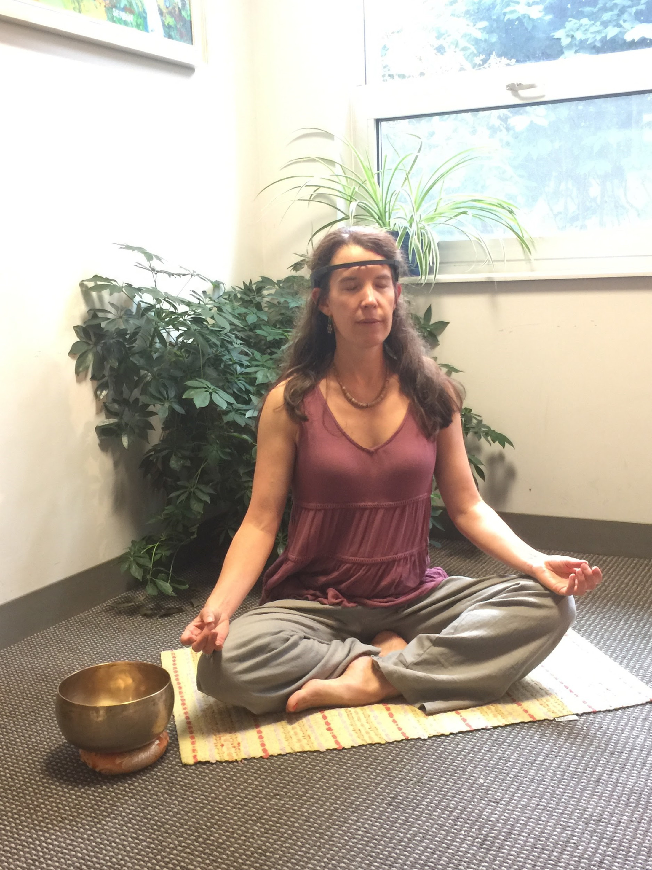 Rebecca Acabchuk practicing meditation and demonstrating the MUSE headband device. Photo provided by Rebecca Acabchuk.