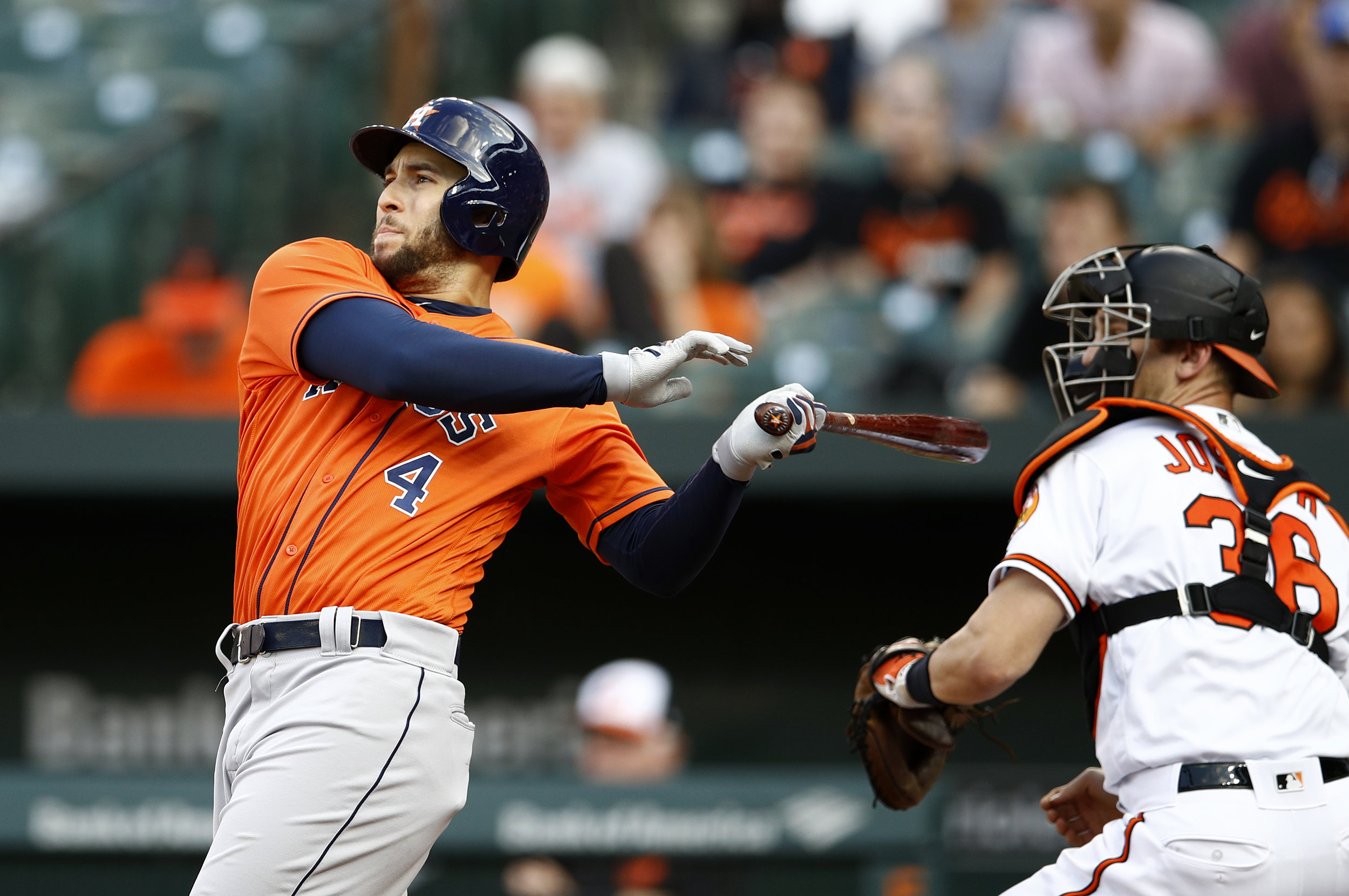 Houston Astros' George Springer hits a two-run home run in front of Baltimore Orioles catcher Caleb Joseph in the sixth inning of the first baseball game of a doubleheader on Saturday, Sept. 29 in Baltimore. (Patrick Semansky/AP)