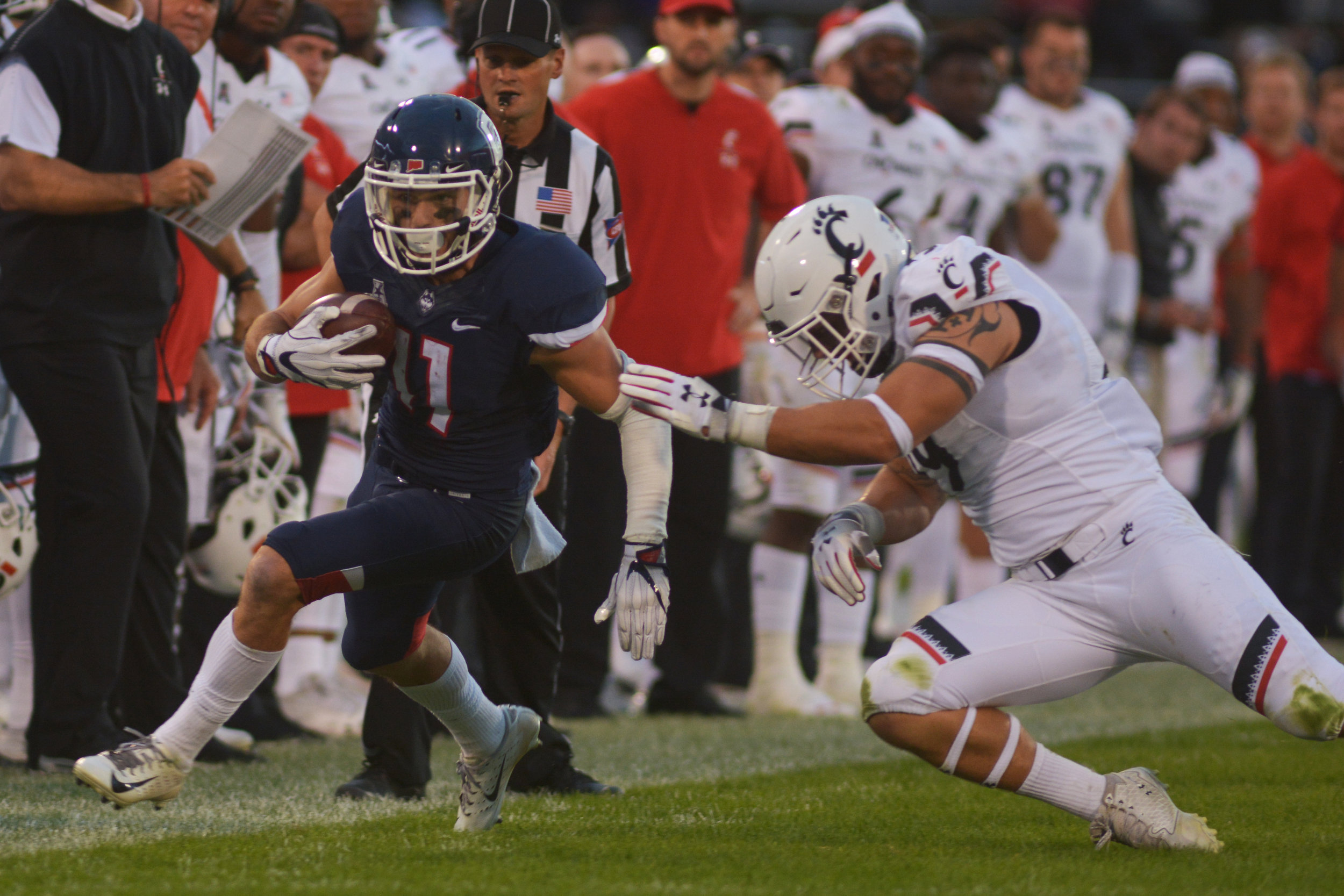 Kyle Buss avoids a Cincinnati opponent during a game on Saturday, Sept. 29 at Rentschler Field. (Nicholas Hampton, Associate Photo Editor/The Daily Campus)