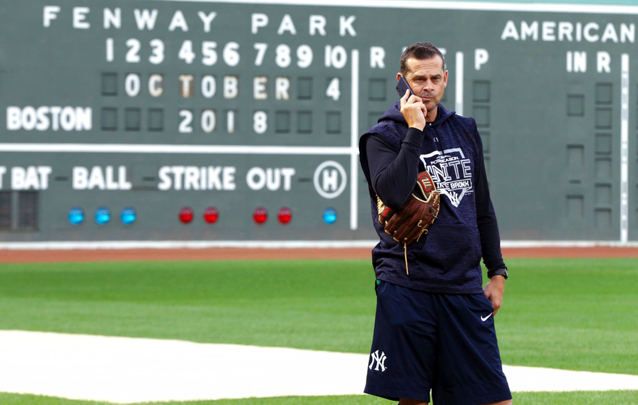 New York Yankees manager Aaron Boone talks on his phone at Fenway Park, Thursday, Oct. 4, 2018, in Boston. The Yankees are scheduled to face the Boston Red Sox in Game 1 of the AL Division Series on Friday. (AP Photo/Elise Amendola)