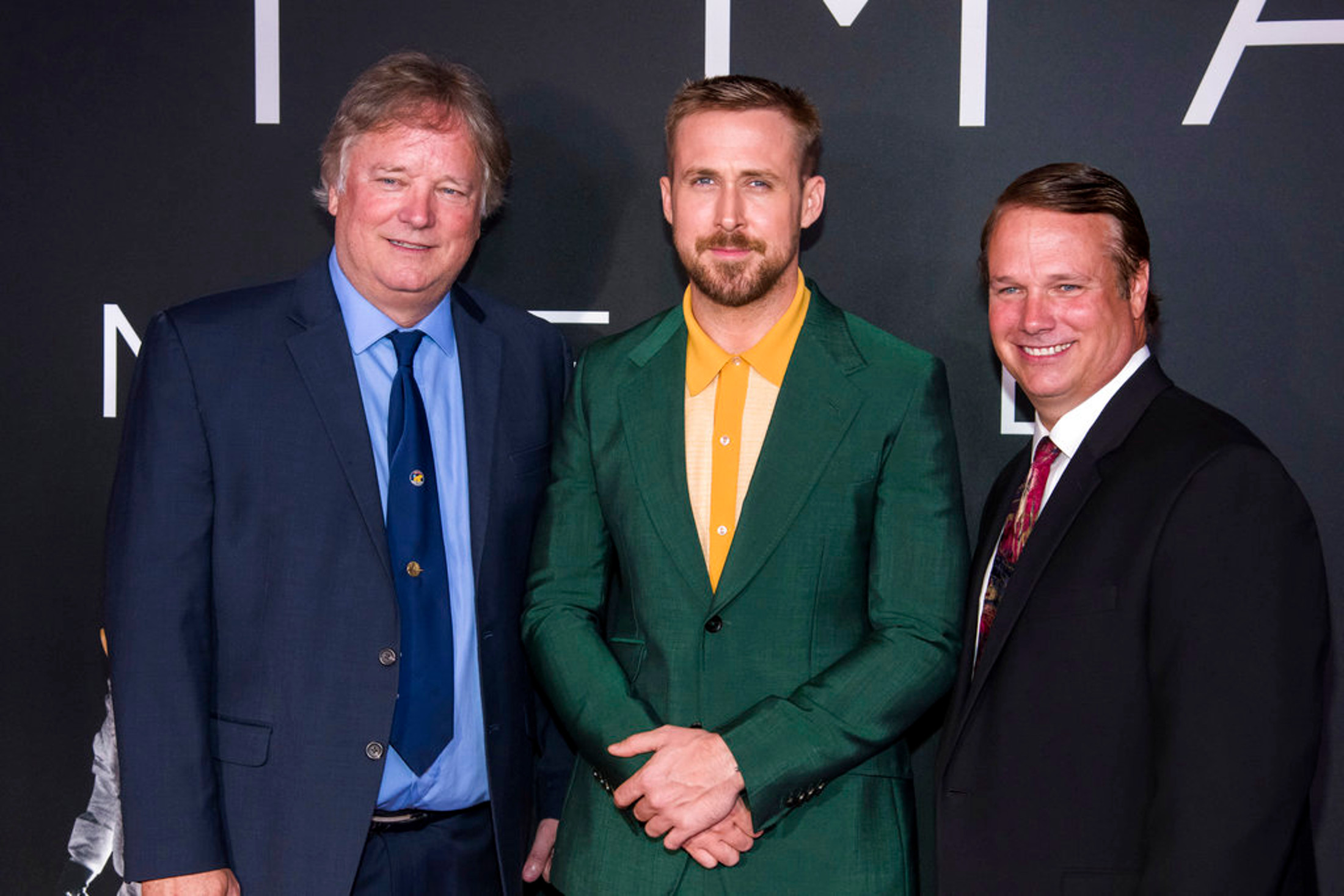 "Rick Armstrong, left, Ryan Gosling and Mark Armstrong attend the ""First Man"" premiere at the National Air and Space Museum of the Smithsonian Institution on Thursday, Oct. 4, 2018, in Washington. (Photo by Charles Sykes/Invision/AP)"