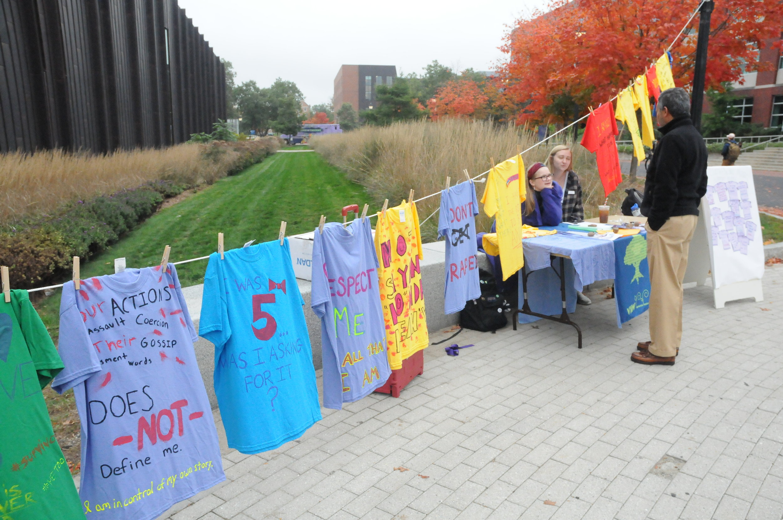 The Women's Center exhibits a project called the clothesline project, in which women, who were victims of sexual assault, created a t-shirt to be displayed. (Hanaisha Lewis/The Daily Campus)