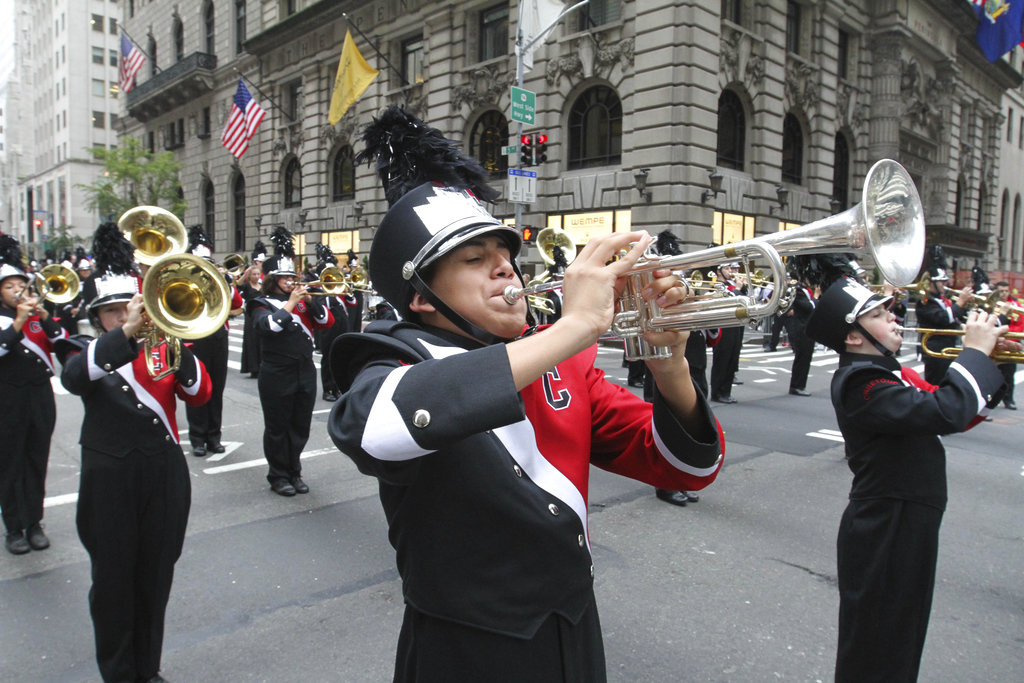 Members of the Connetquot High School marching band, from Bohemia, New York, make their way up Fifth Avenue as they take part in the Columbus Day parade, Monday, Oct. 8, 2018 in New York. (AP Photo/Tina Fineberg)