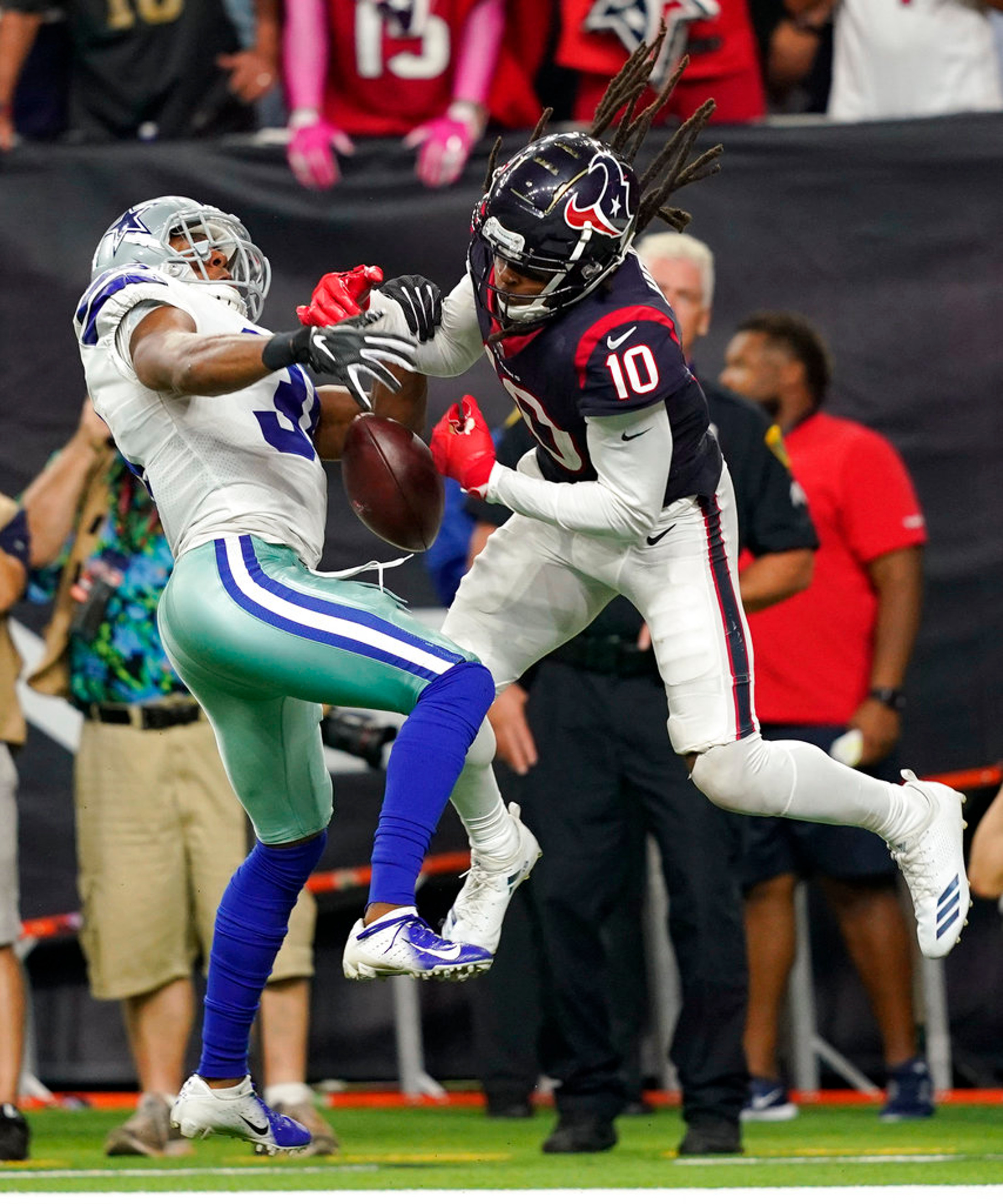 Dallas Cowboys cornerback Byron Jones (31) breaks up a pass in the end zone intended for Houston Texans wide receiver DeAndre Hopkins (10) during the second half of an NFL football game, Sunday, Oct. 7, 2018, in Houston. (AP Photo/David J. Phillip)