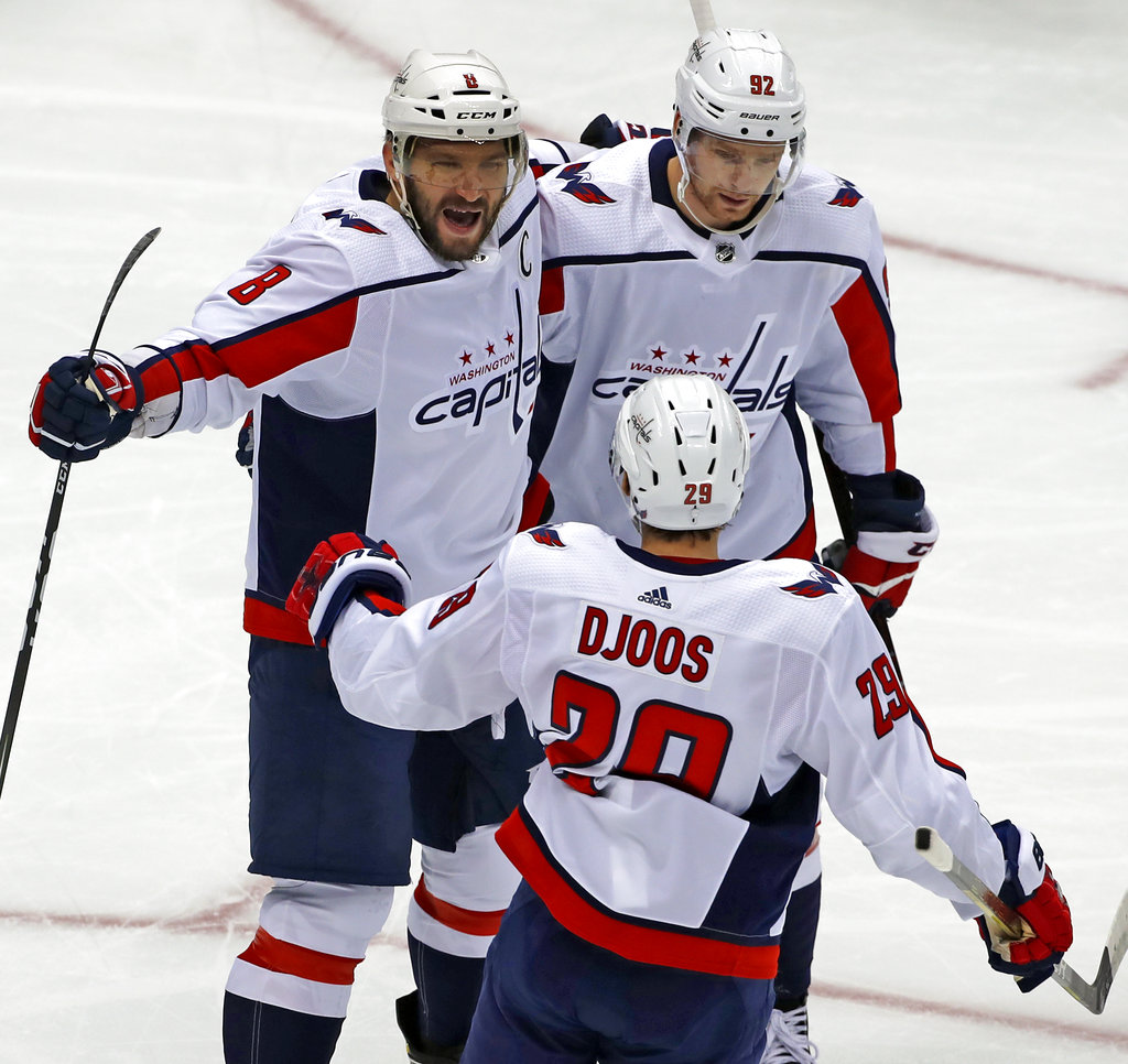 Washington Capitals' Alex Ovechkin (8) celebrates his goal with Evgeny Kuznetsov (92) and Christian Djoos (29) during the first period of an NHL hockey game against the Pittsburgh Penguins in Pittsburgh, Thursday, Oct. 4, 2018. (AP Photo/Gene J. Puskar)