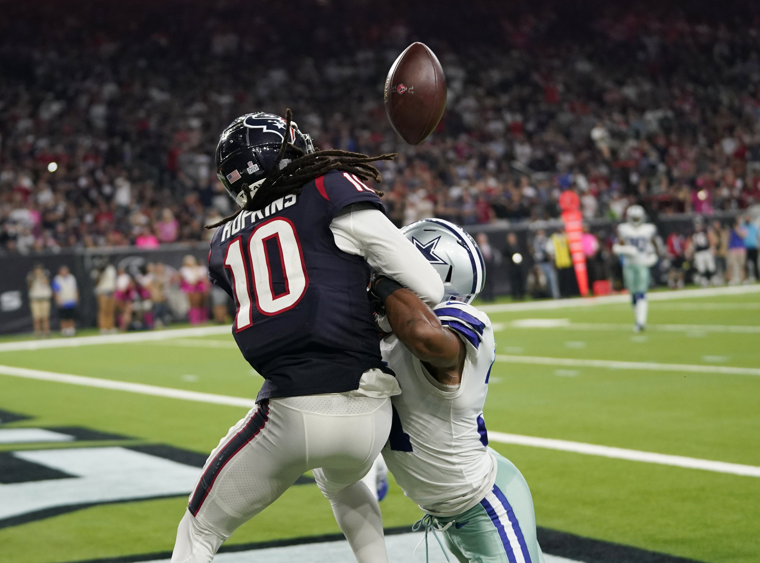 Byron Jones, right, breaks up a pass in the end zone intended for Houston Texans wide receiver DeAndre Hopkins (10) a game, Sunday, Oct. 7, 2018, in Houston. (AP Photo/David J. Phillip)