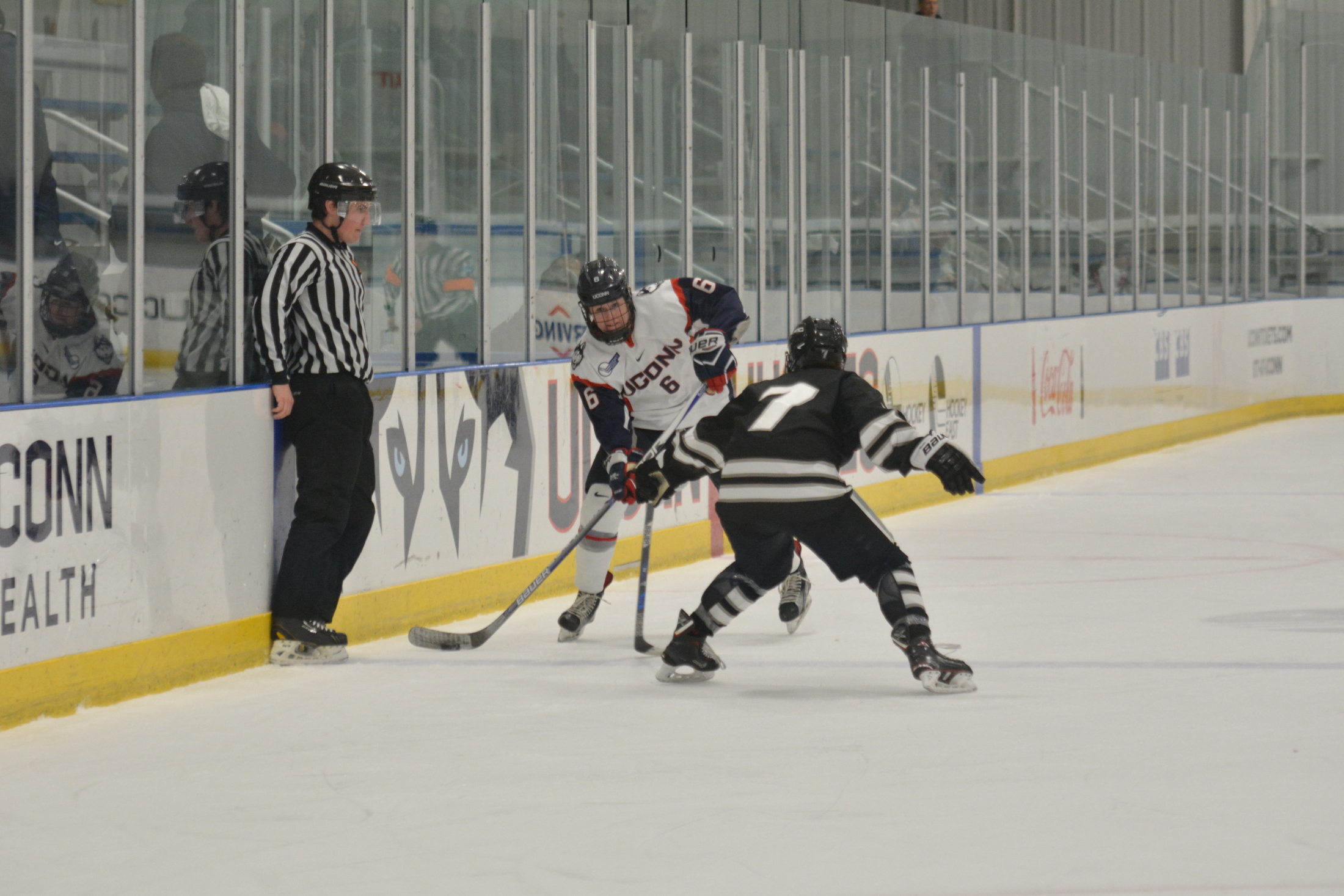 Women's Hockey moves the puck against Providence College, a Hockey East opponent (File Photo/The Daily Campus)