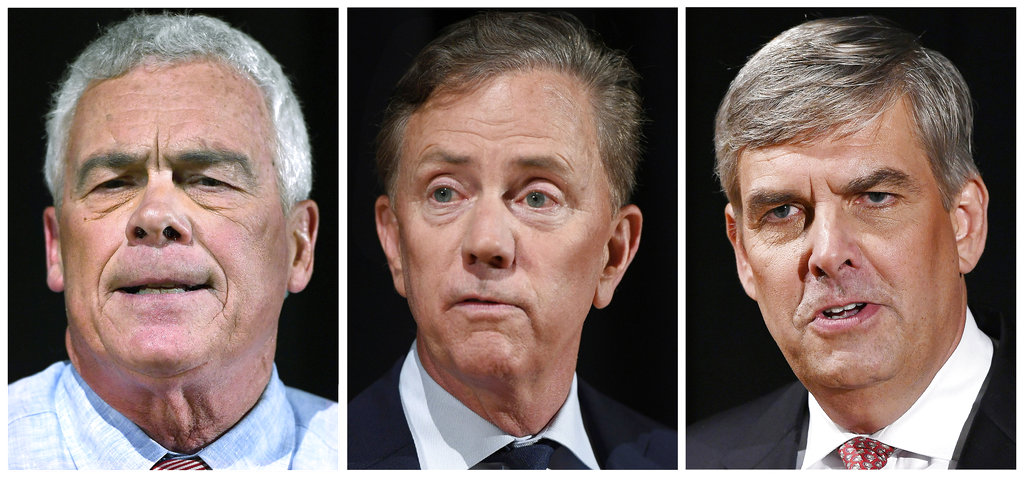 FILE - This panel of Sept. 26, 2018 file photos shows Independent candidate Oz Griebel, left, Democrat Party candidate Ned Lamont, center, and Republican Party candidate Bob Stefanowski after a gubernatorial debate at the University of Connecticut in Storrs, Conn. The three men are running for governor of Connecticut in the November general election. (AP Photo/Jessica Hill, File)