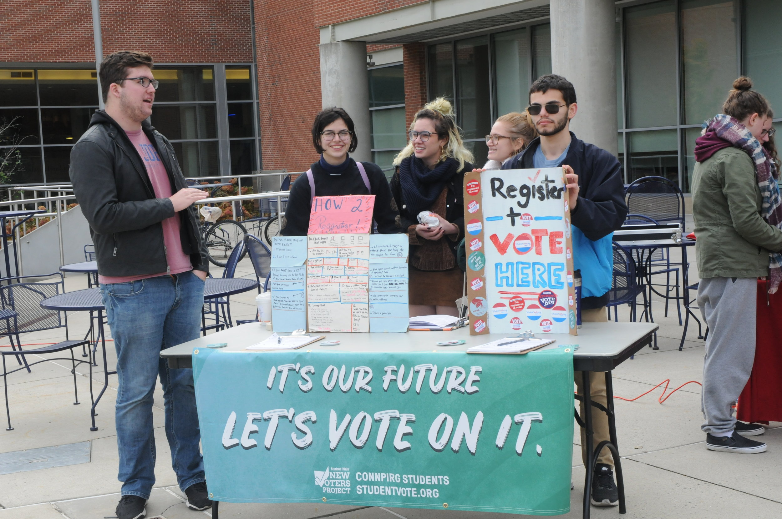 Several University of Connecticut organizations hosted giveaways, talked to students about voting and offered free cake to get students excited about voting in this year's midterm elections at UConnPIRG's Ballot Block Party on Friday. (Brandon Barzola/The Daily Campus)