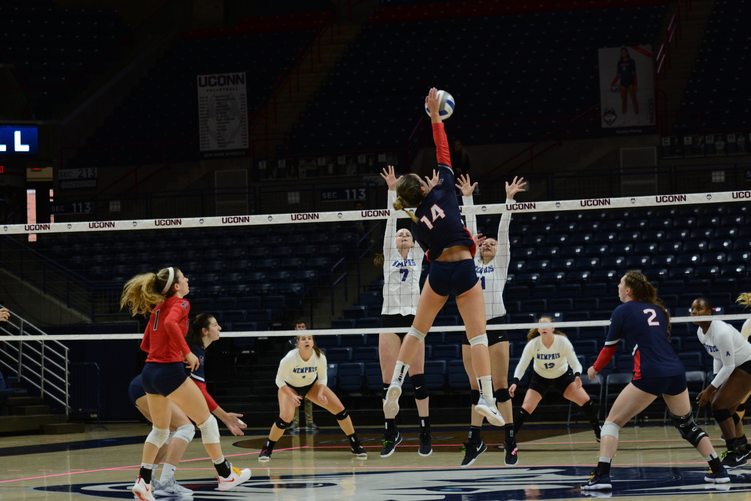 Caylee Parker rises up for a kill against Memphis during a five-set game at Gampel Pavilion Sunday Oct. 21. The freshman finished with 21 kills. Photo by Judah Shingleton, Staff Photographer/The Daily Campus