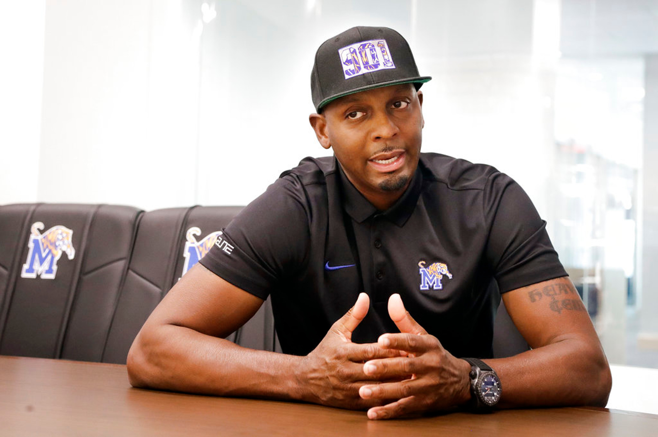 FILE - In this June 8, 2018, file photo, Memphis basketball coach Penny Hardaway talks about his new job in the school's basketball offices in Memphis, Tenn. Memphis hired Hardaway last spring after letting Tubby Smith go after community interest and fans dwindled at Tigers' games. Memphis is hoping its favorite son can pick up the pieces. (AP Photo/Mark Humphrey, File)