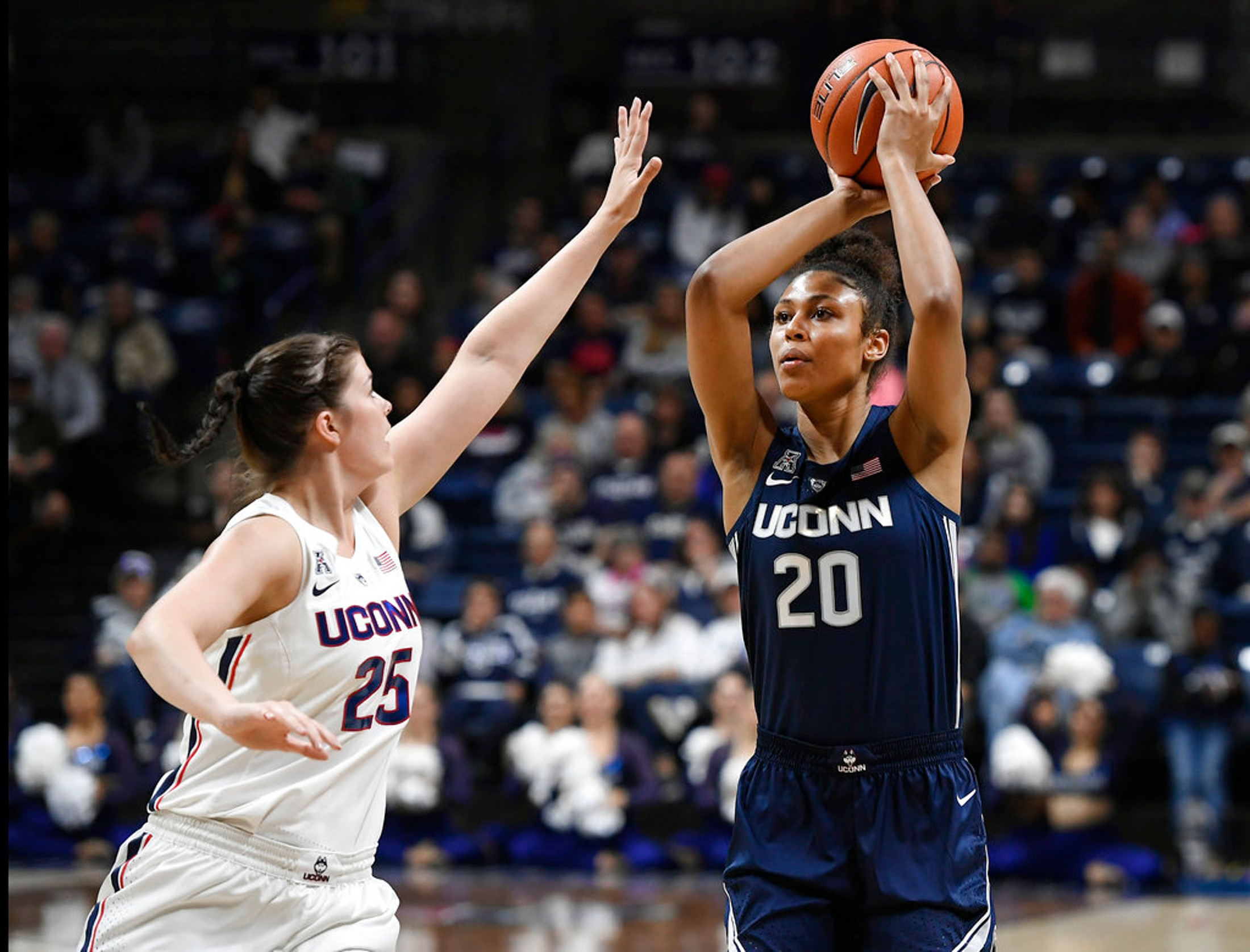 FILE - In this Friday, Oct. 12, 2018 file photo, Connecticut's Olivia Nelson-Ododa is guarded by Connecticut's Kyla Irwin during the UConn's men's and women's basketball teams annual First Night celebration, in Storrs, Conn. (AP Photo/Jessica Hill, File)