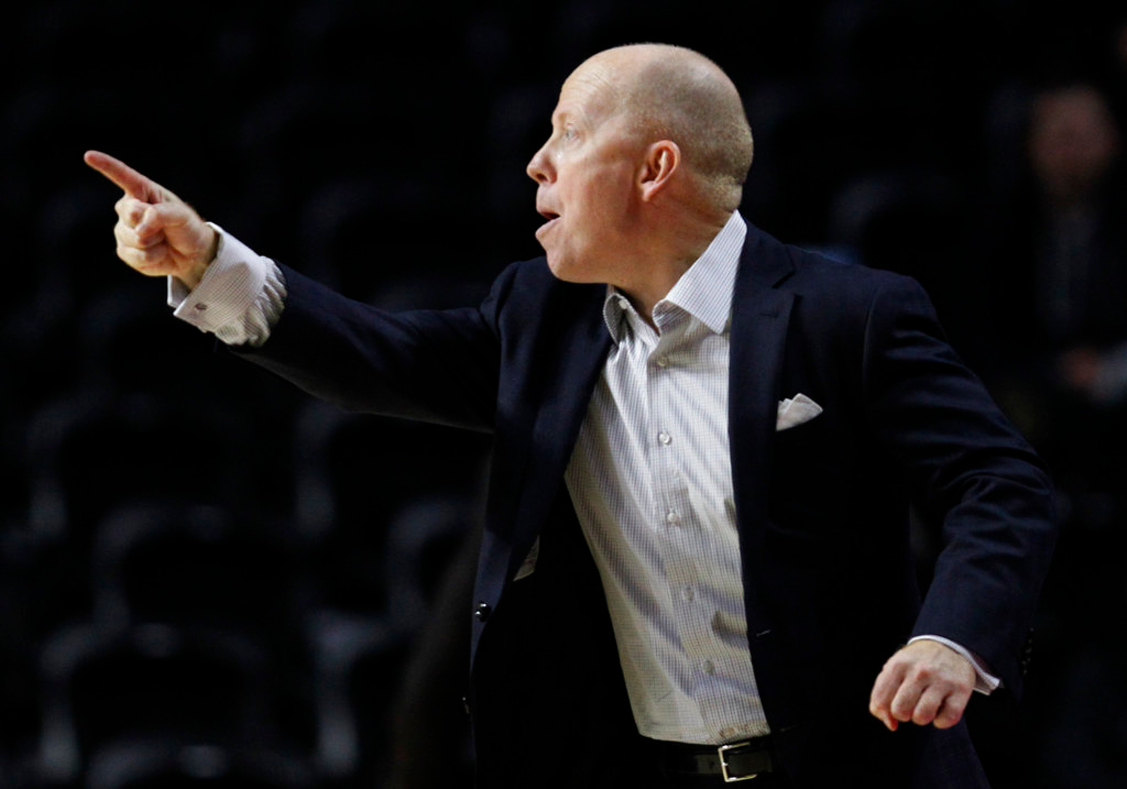 FILE - In this Jan. 4, 2018, file photo, Cincinnati head coach Mike Cronin shouts from the sideline during the first half of an NCAA college basketball game against Temple, in Philadelphia. The Bearcats had a resurgent season while playing away from home while their arena was refurbished, winning the American Athletic championship before losing in the second round of the NCAA Tournament. They're looking to build upon that success as they move back into their on-campus arena this season. (AP Photo/Laurence Kesterson, File)
