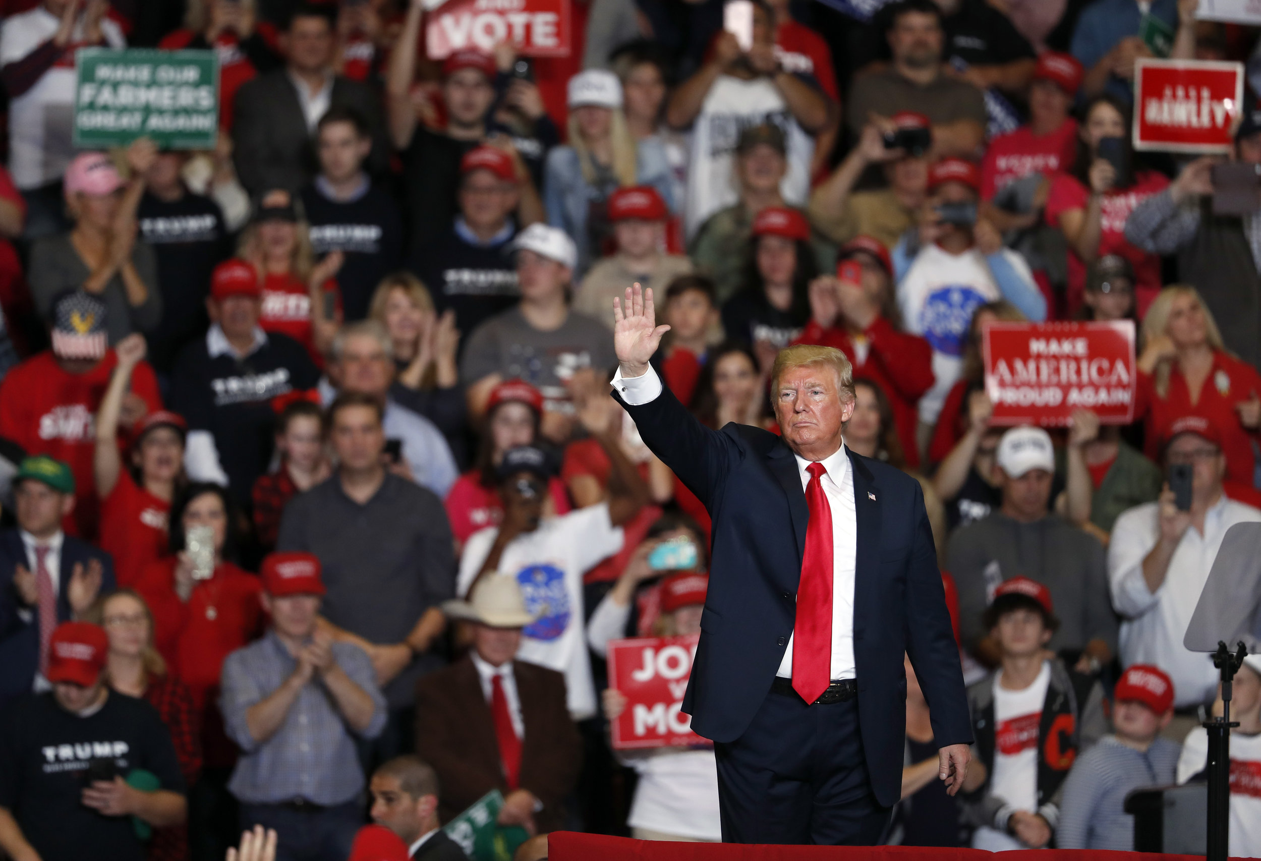 President Donald Trump waves to the crowd as he leaves the stage at the end of a campaign rally Monday, Nov. 5, 2018, in Cape Girardeau, Mo. (AP Photo/Jeff Roberson)