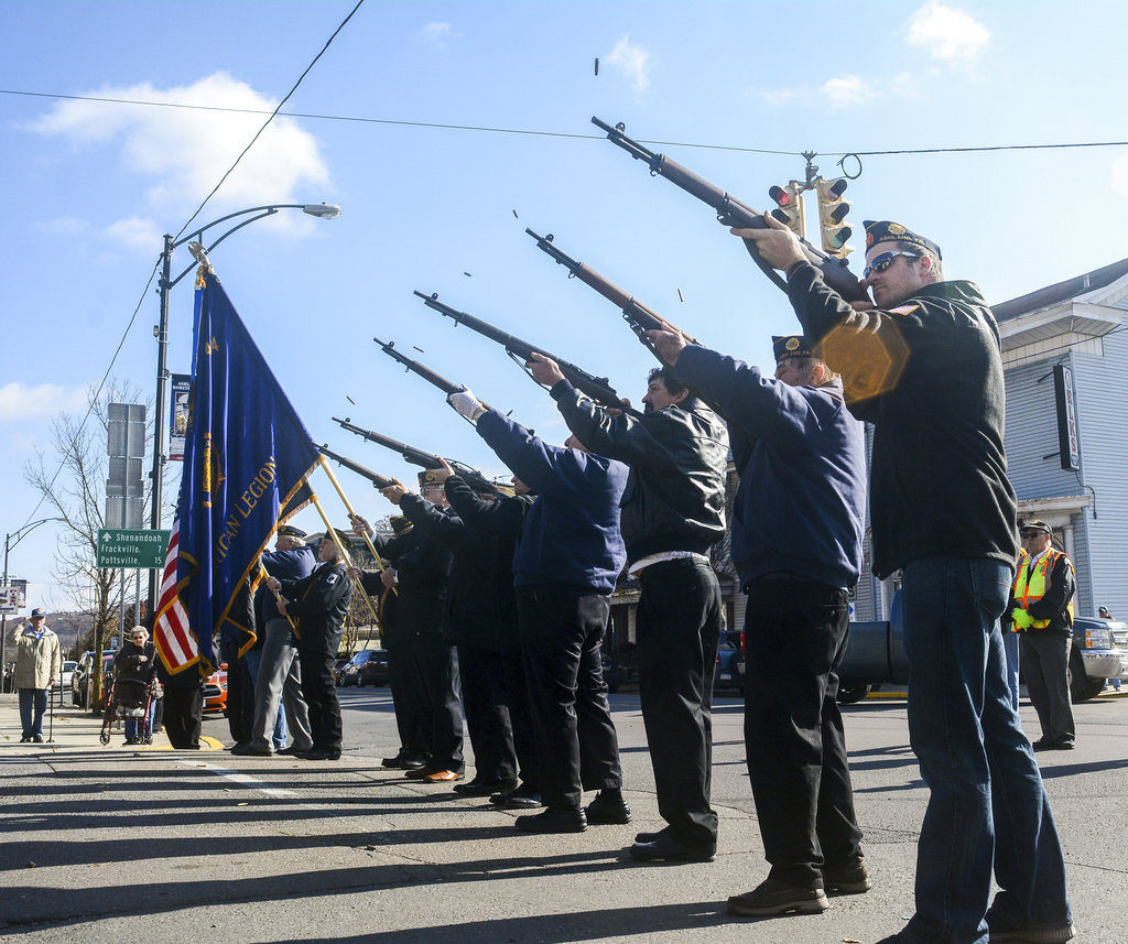 The VFW Post 7654 honor guard gives a 21-gun salute at the annual Veterans Day ceremony in Ashland, Pa., on Sunday, Nov. 11, 2018. (Andy Matsko/The Republican-Herald via AP)