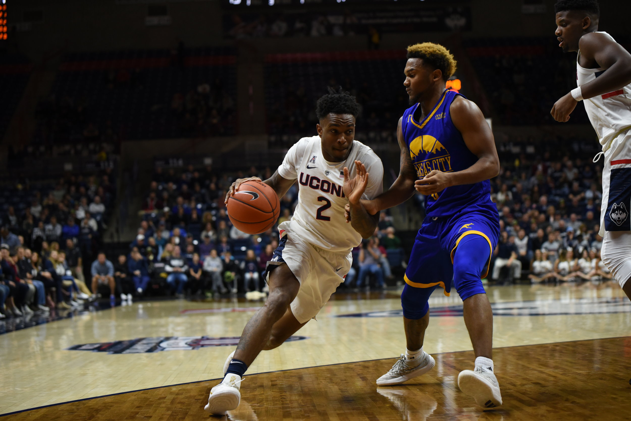 Tarin Smith pushes past a UMKC defender during a game on Nov. 11, 2018. (Nicholas Hampton/ The Daily Campus)