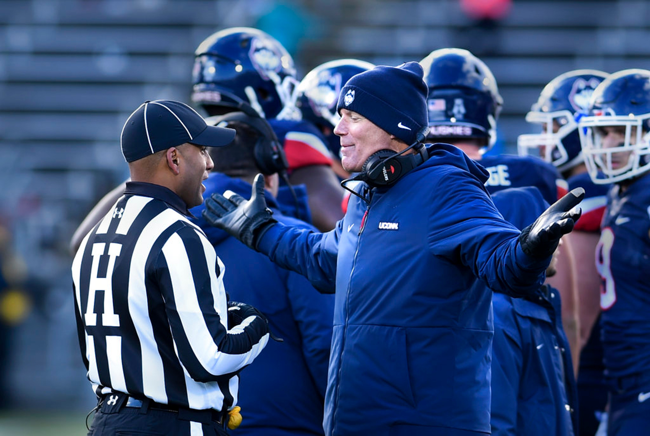 Connecticut head coach Randy Edsall pleads with an official during a time out in the second half of an NCAA college football game against SMU, Saturday, Nov. 10, 2018, in East Hartford, Conn.(AP Photo/Stephen Dunn)