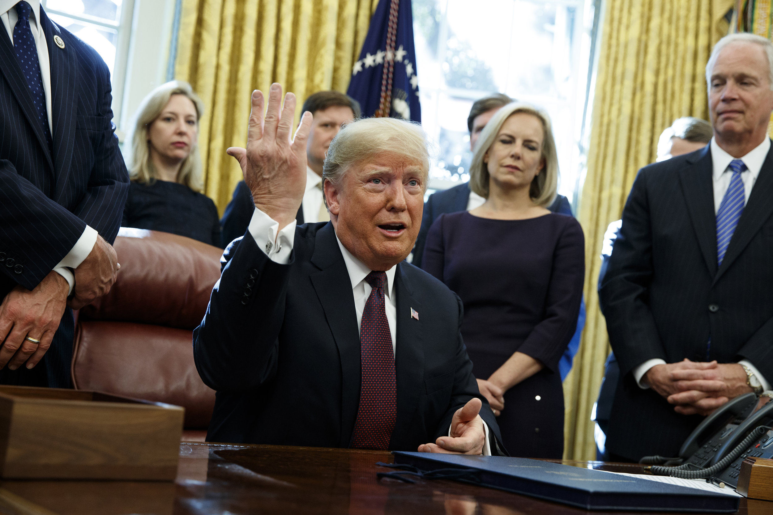 President Donald Trump answers a reporters question about the investigation of special counsel Robert Mueller in the Oval Office of the White House, Friday, Nov. 16, 2018, in Washington. (AP Photo/Evan Vucci)